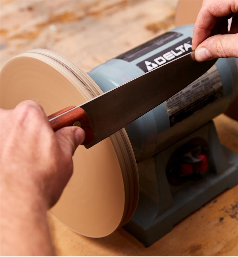 Honing a knife blade using the polishing wheel of the razor sharp kit