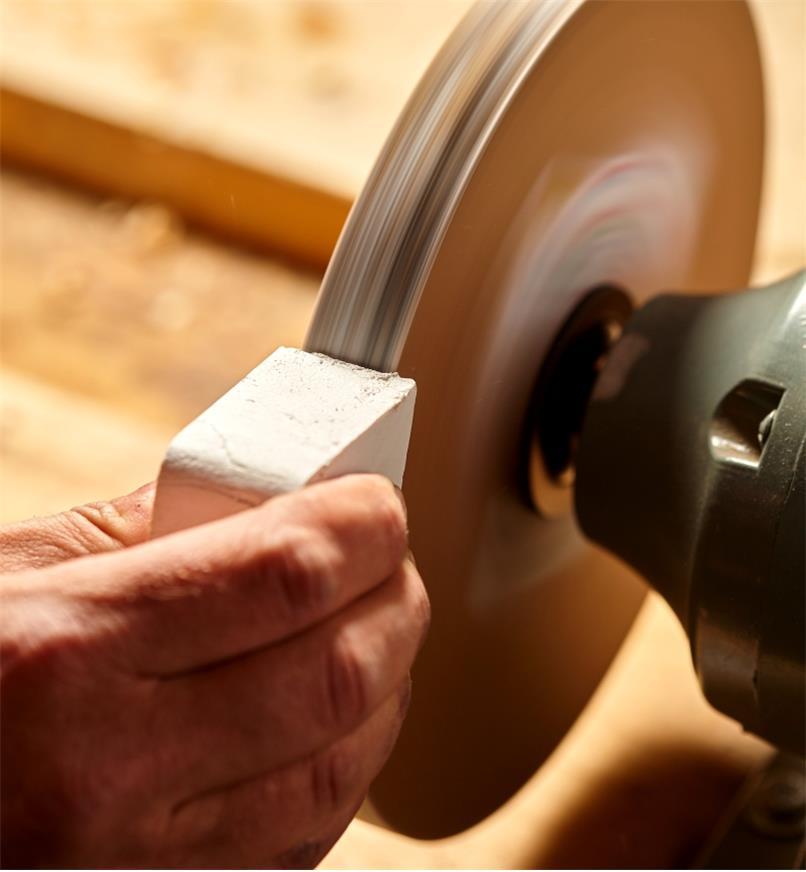 Applying jeweller's rouge to the polishing wheel of the razor sharp kit