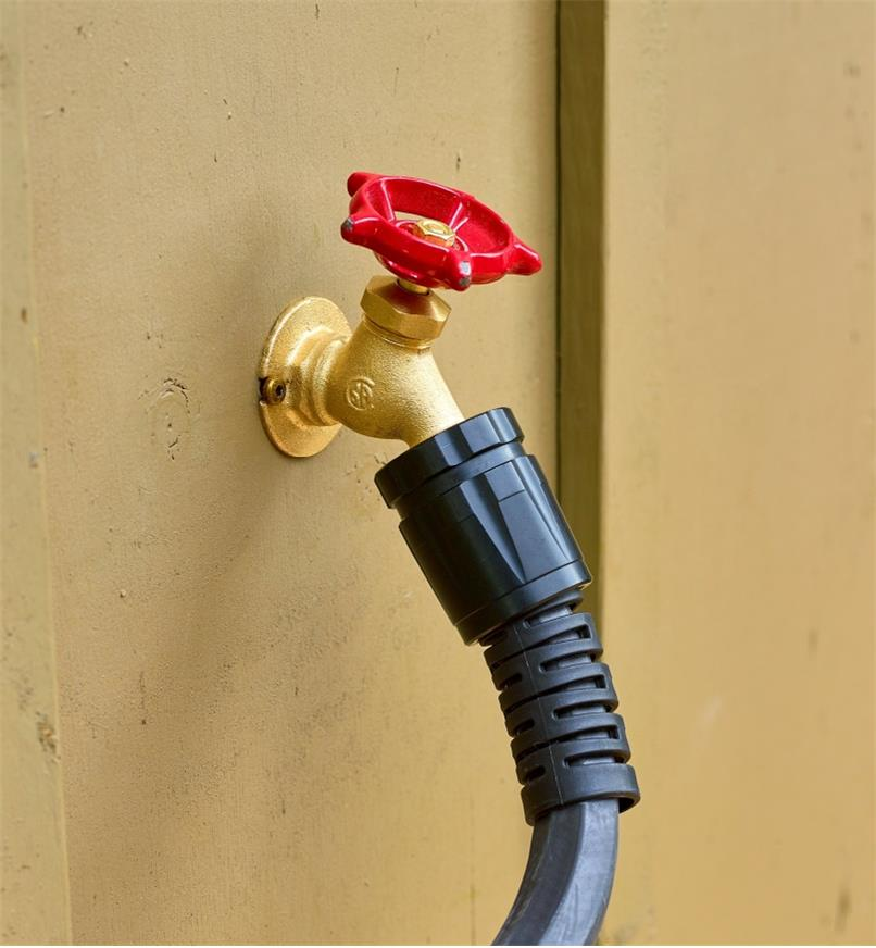 Close-up of plastic cuff at end of a Viper hose connected to a faucet