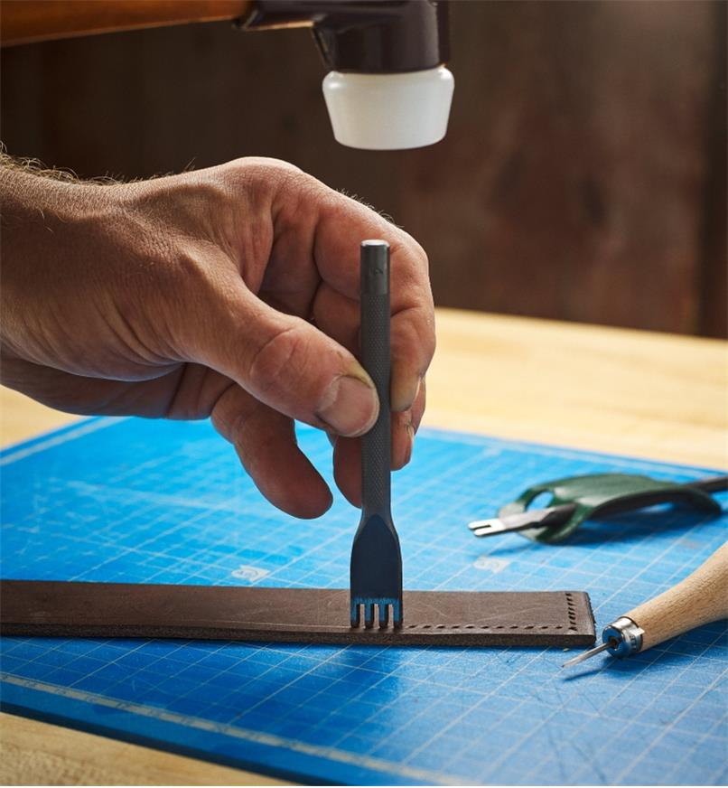 Punching perforations into leather using the four-point chisel and a mallet