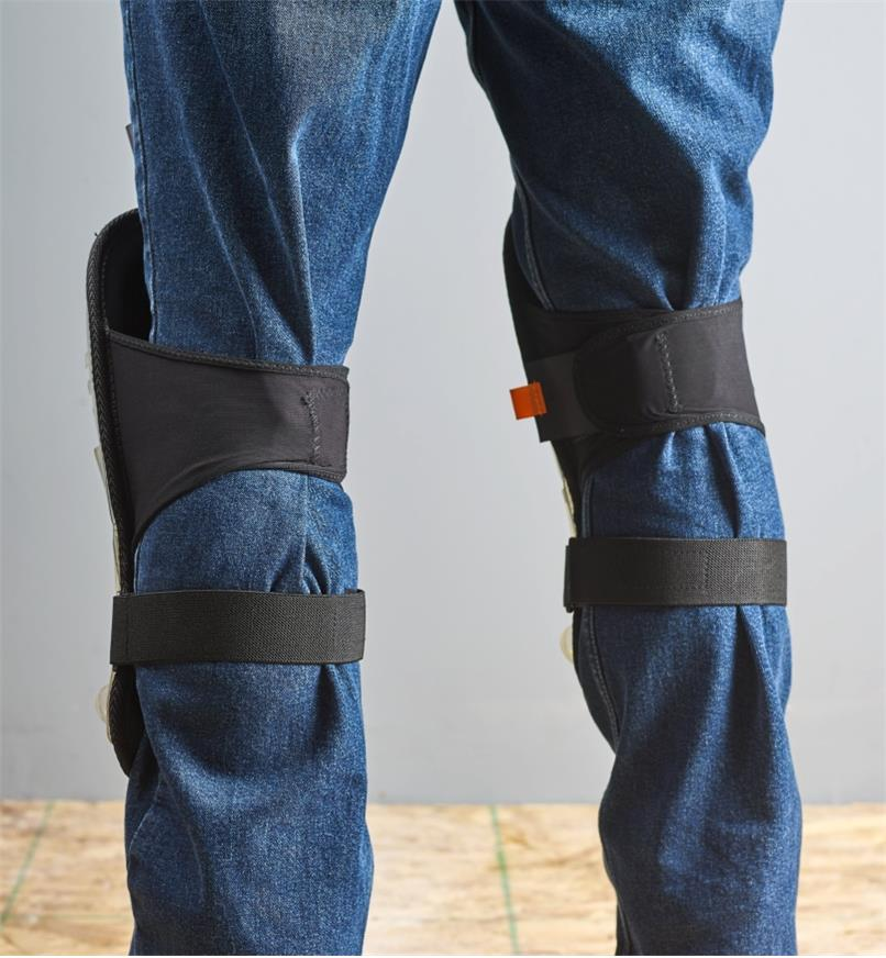 Back view of the large premium knee pads strapped to a person's knees
