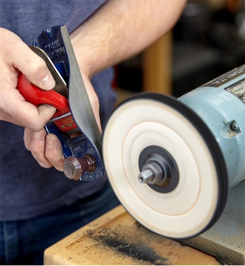 Polishing a block plane cheek with the cloth buffing wheel