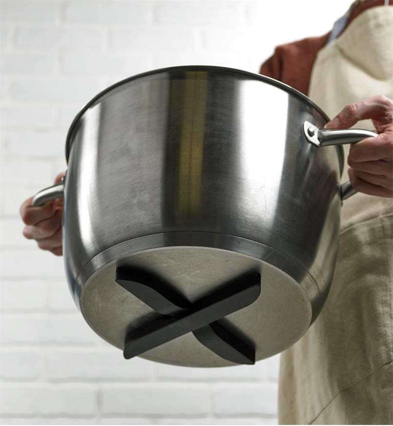 X-shaped magnetic trivet attached to the bottom of a steel pot