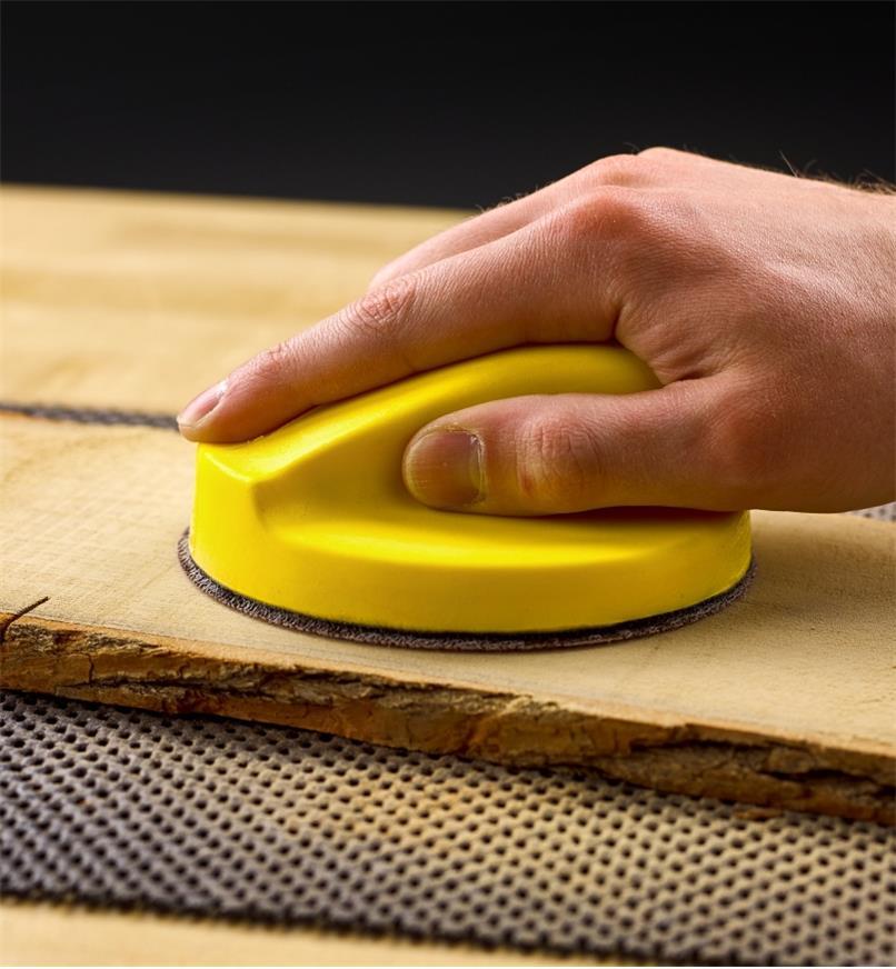 "Gripping the 5"" disc sanding block"