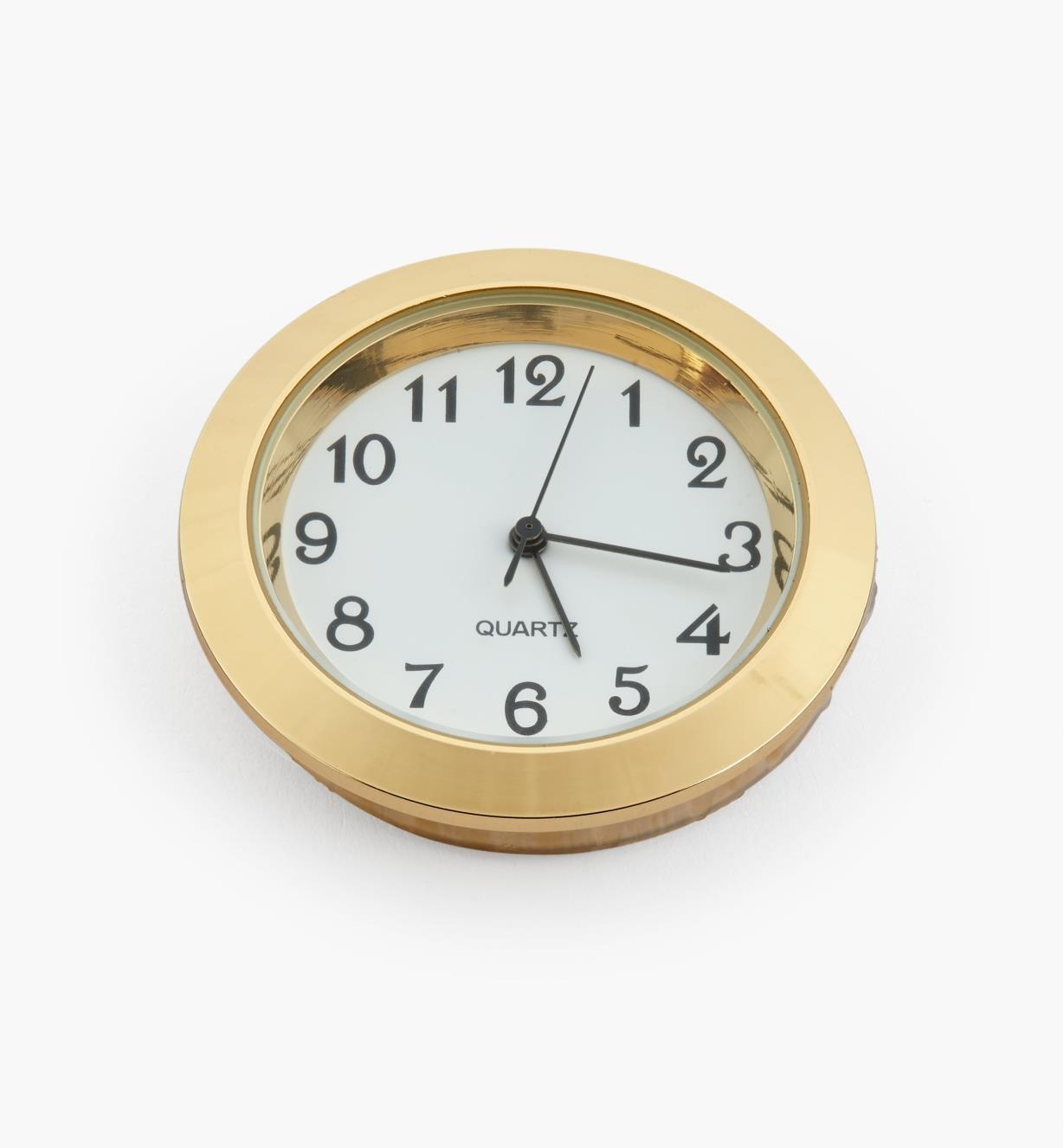 44K0150 - Horloge, cadran blanc à chiffres arabes, lunette or