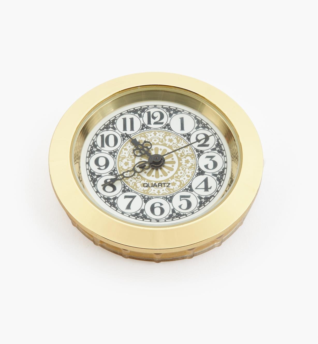 44K0156 - Horloge, cadran à motifs à chiffres arabes, lunette or