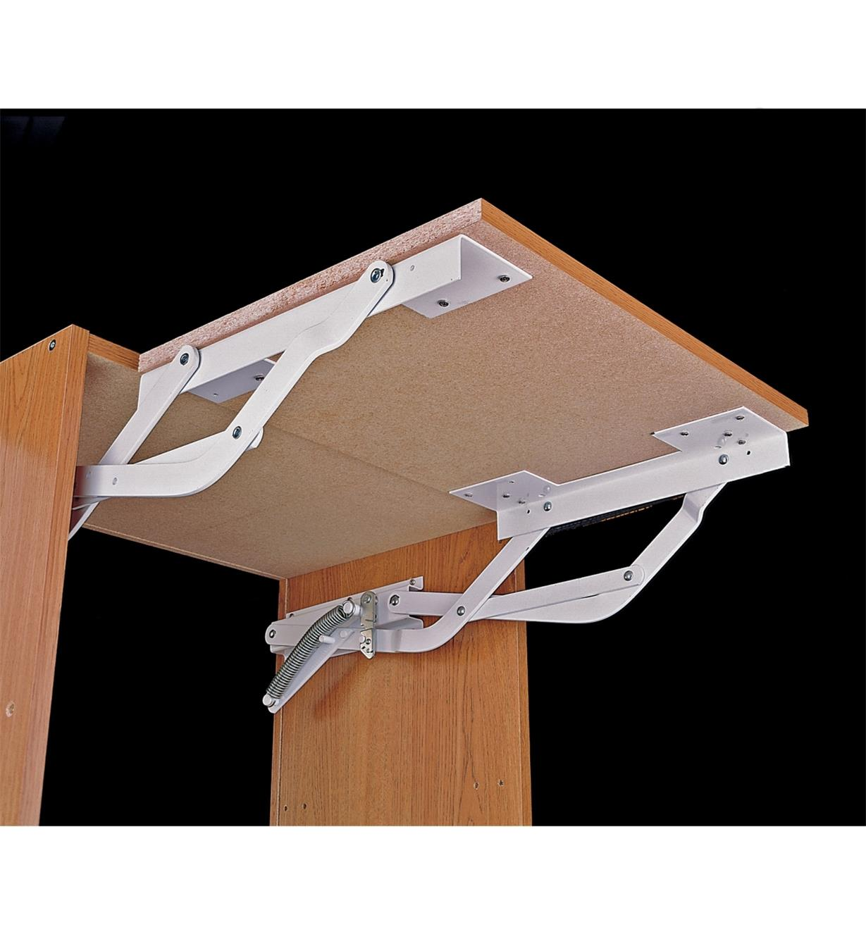 A swing-up shelf made with the Appliance Lifter Brackets