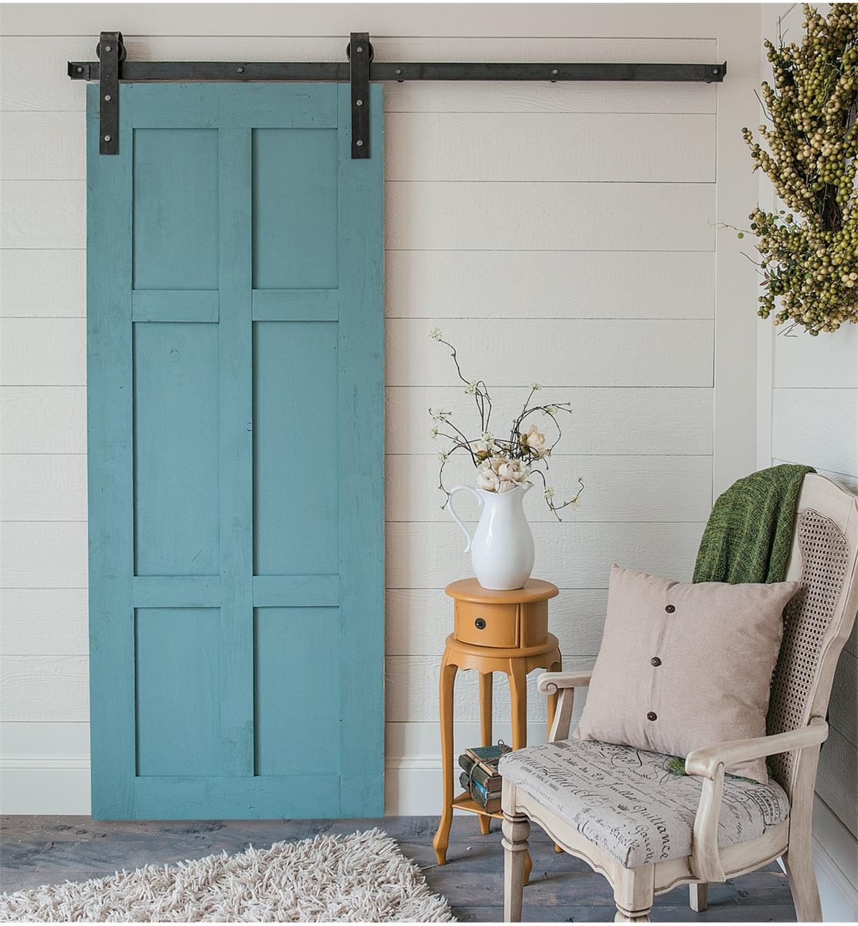 Example of door hung with Classic Face-Mount Barn-Style Door Hardware