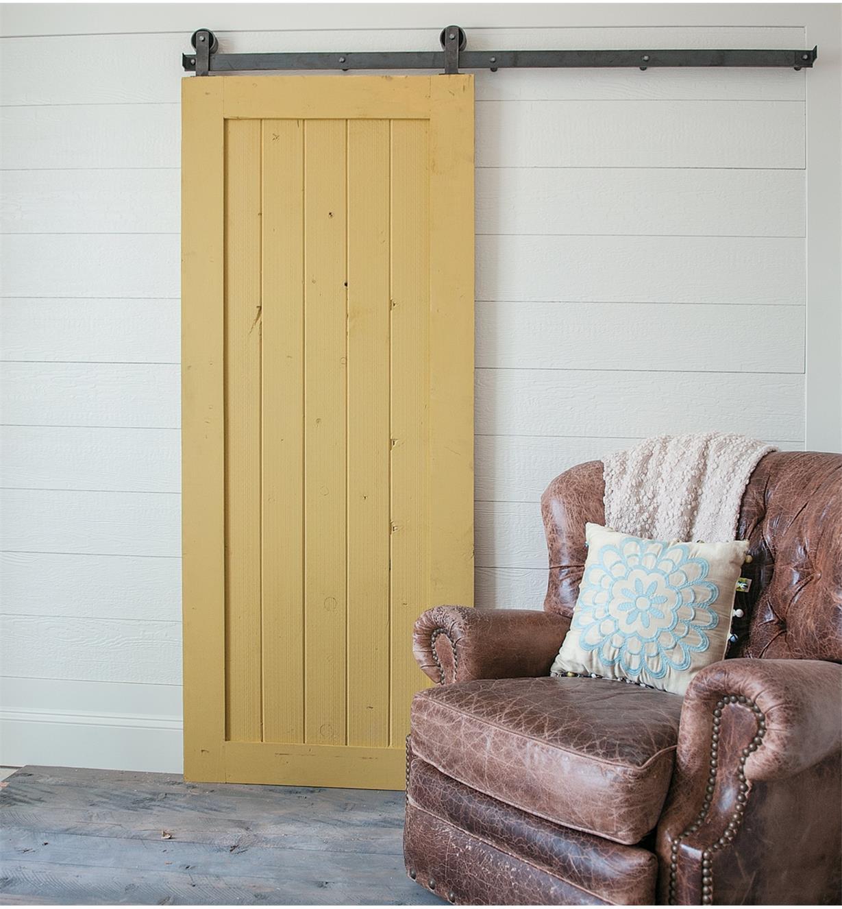 A door mounted with Classic Top-Mount Barn-Style Door Hardware
