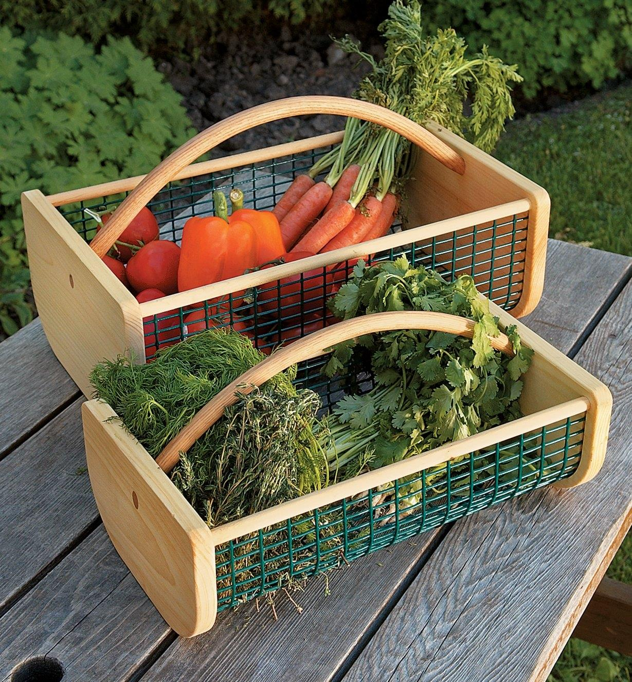 Large and medium Maine Garden Hods filled with fresh-picked vegetables, sitting on a picnic table