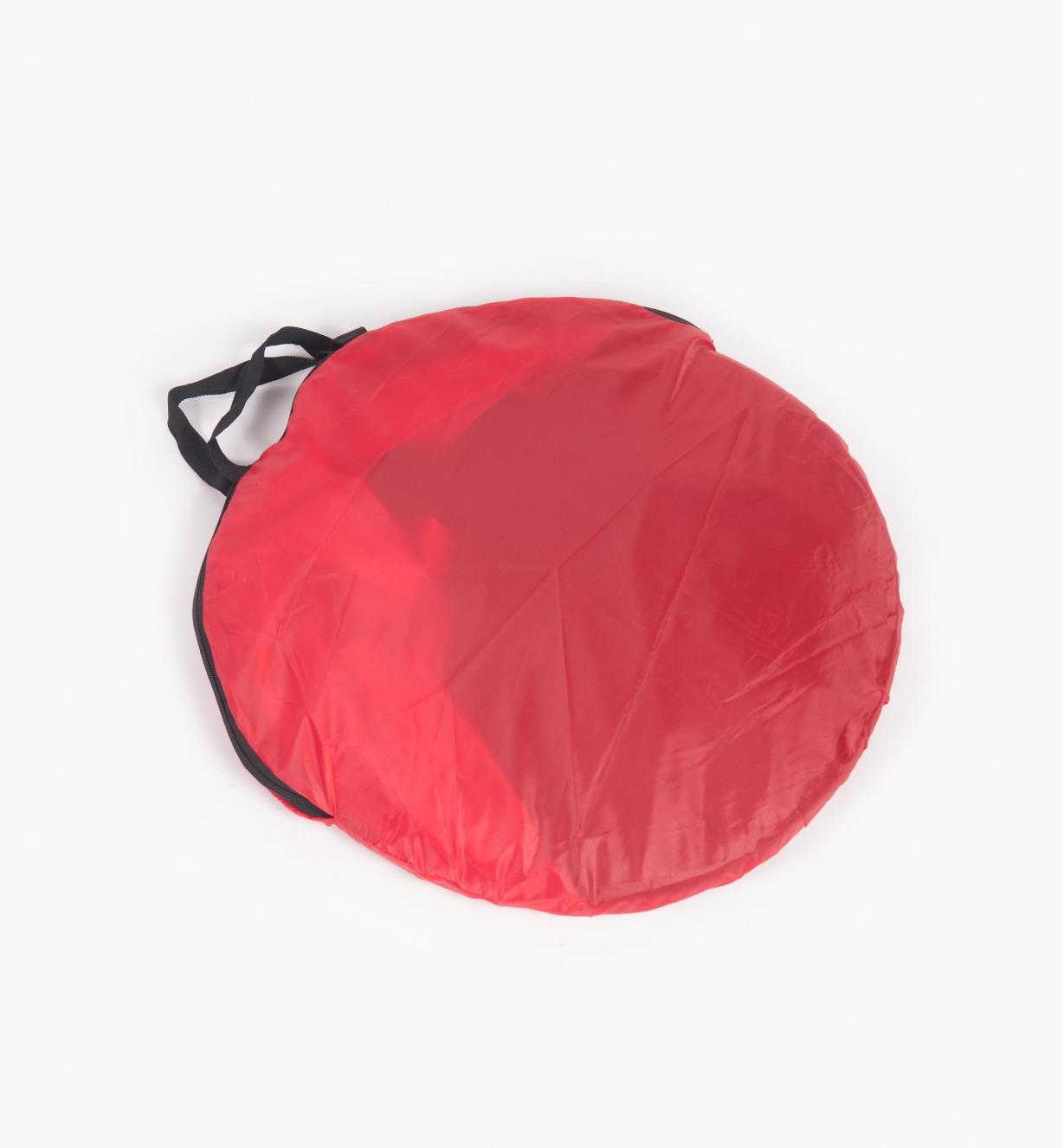 Shelter folded into zippered storage bag.