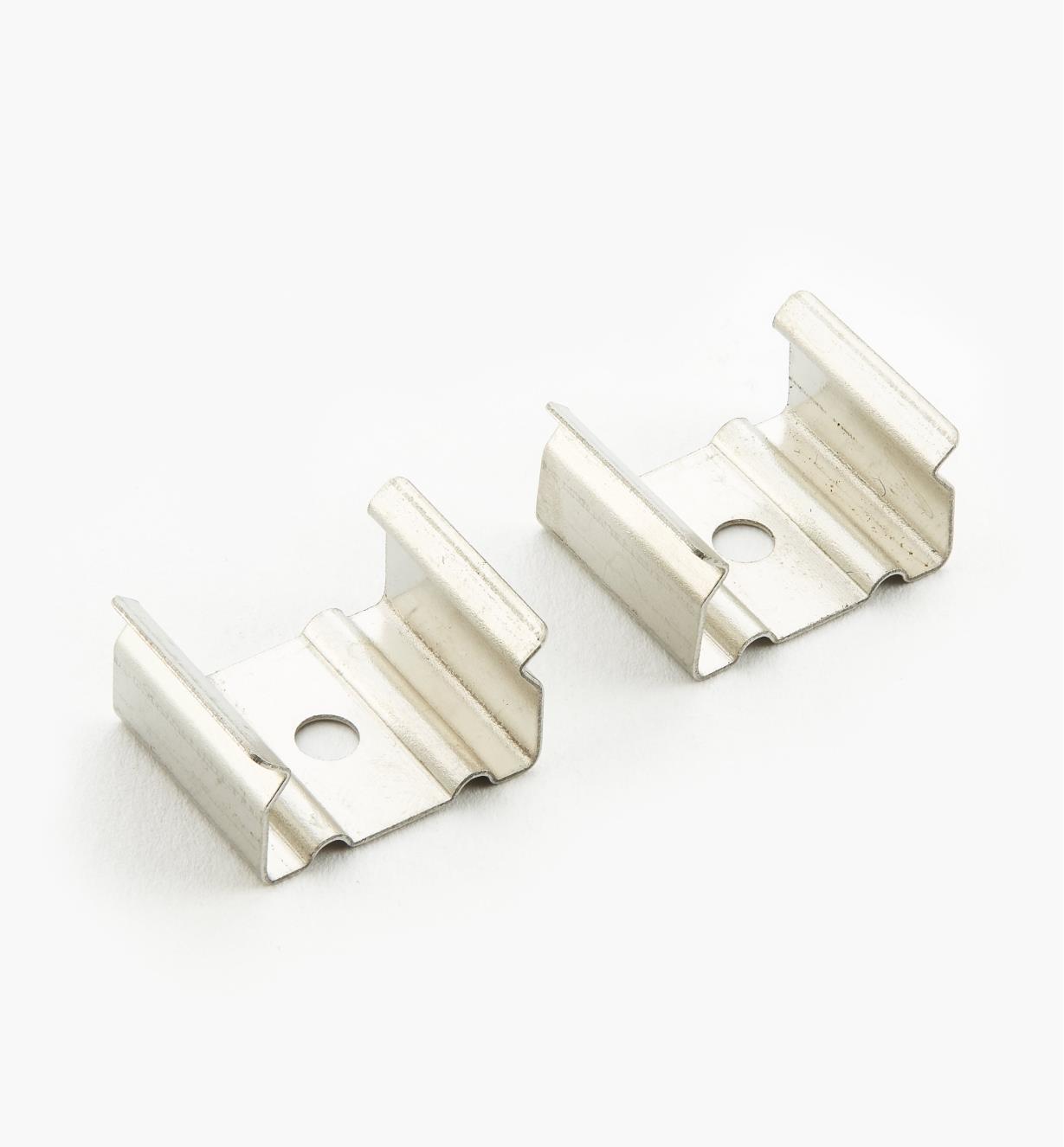 00U4246 - Éléments de fixation pour support à montage en surface et encastrable, lapaire