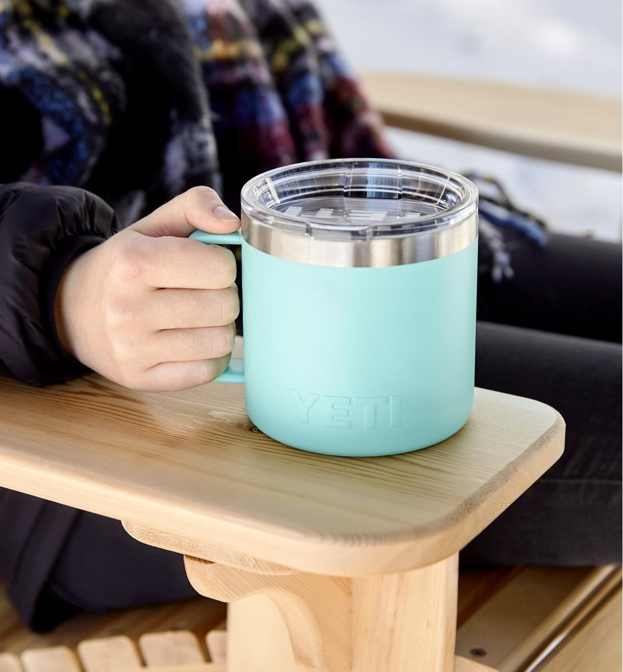 Yeti Rambler mug held on the armrest of an Adirondack deck chair