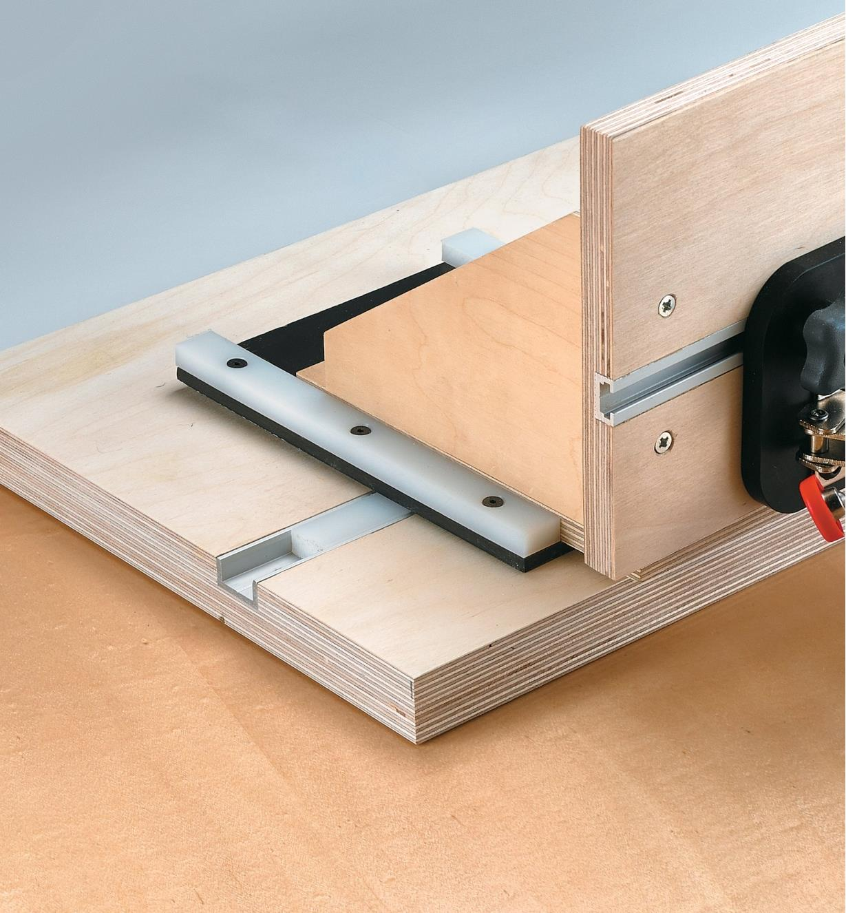 Combination of wide slot extrusion and T-slot track to make a mortising jig
