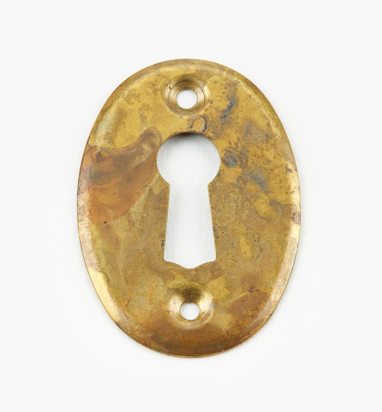 01A1970 - Vertical Pressed Old Brass Escutcheon