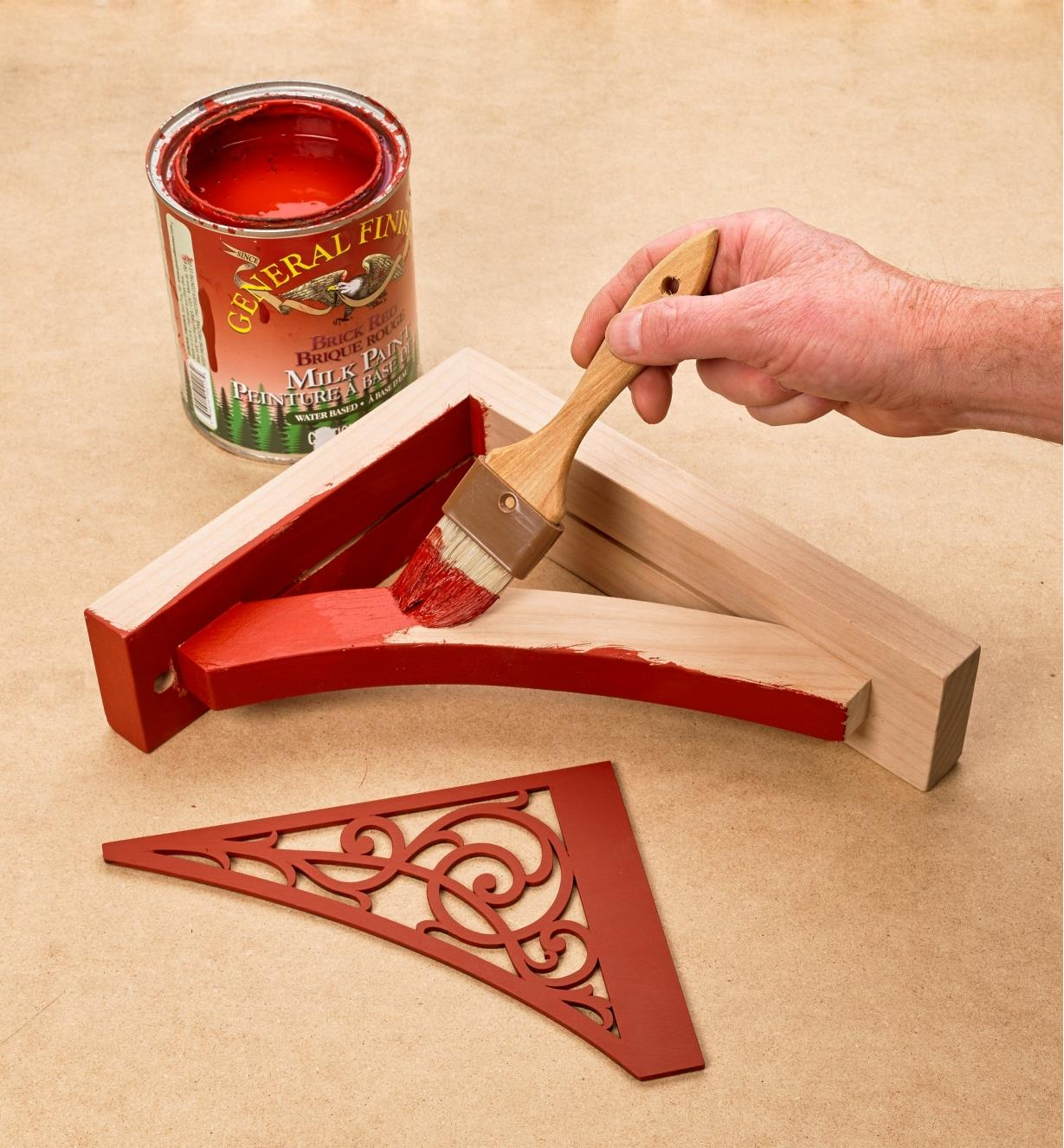 Painting the Scroll Wooden Shelf Bracket with red milk paint