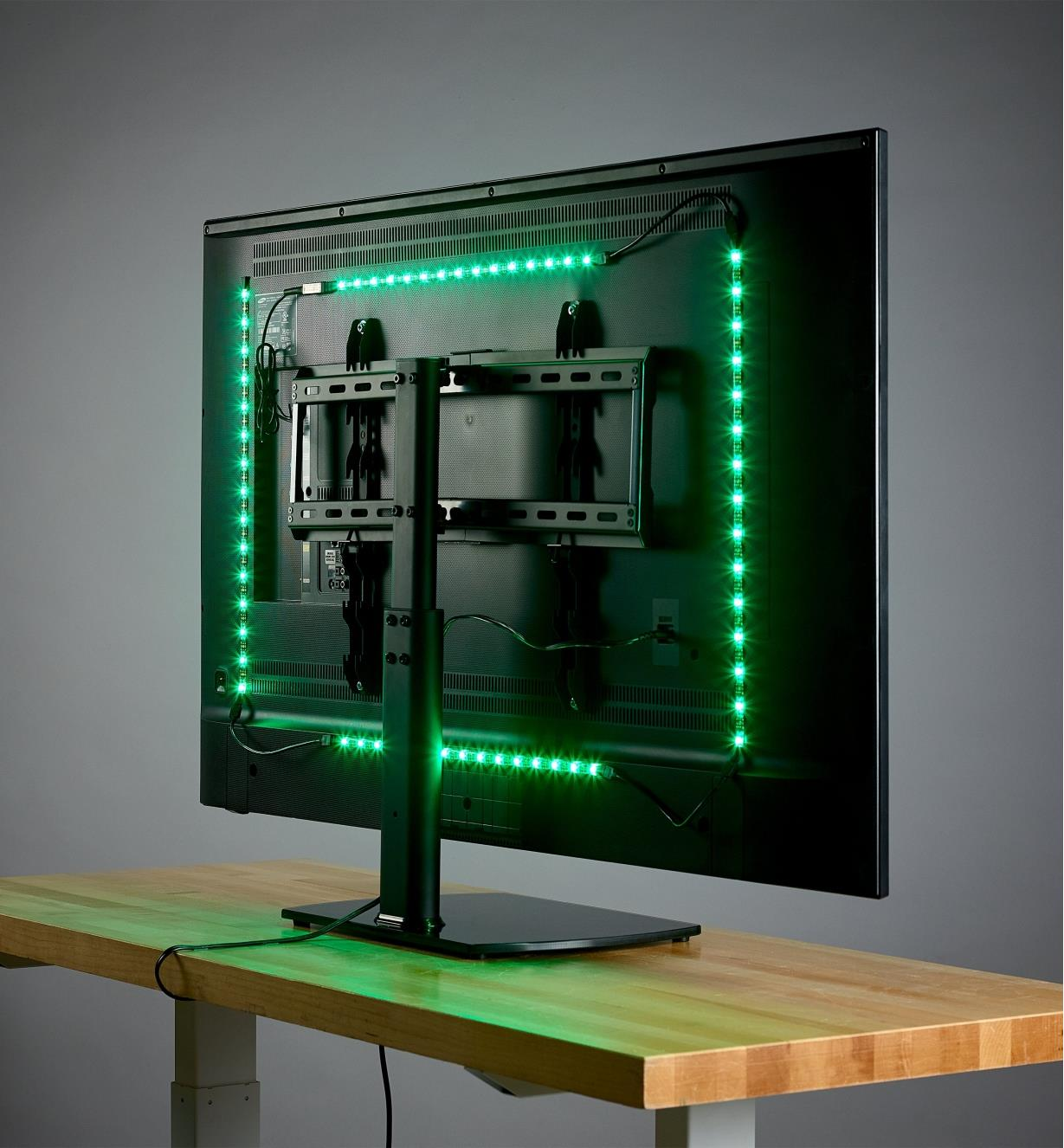 A USB LED tape light kit shown mounted on the back of a computer monitor