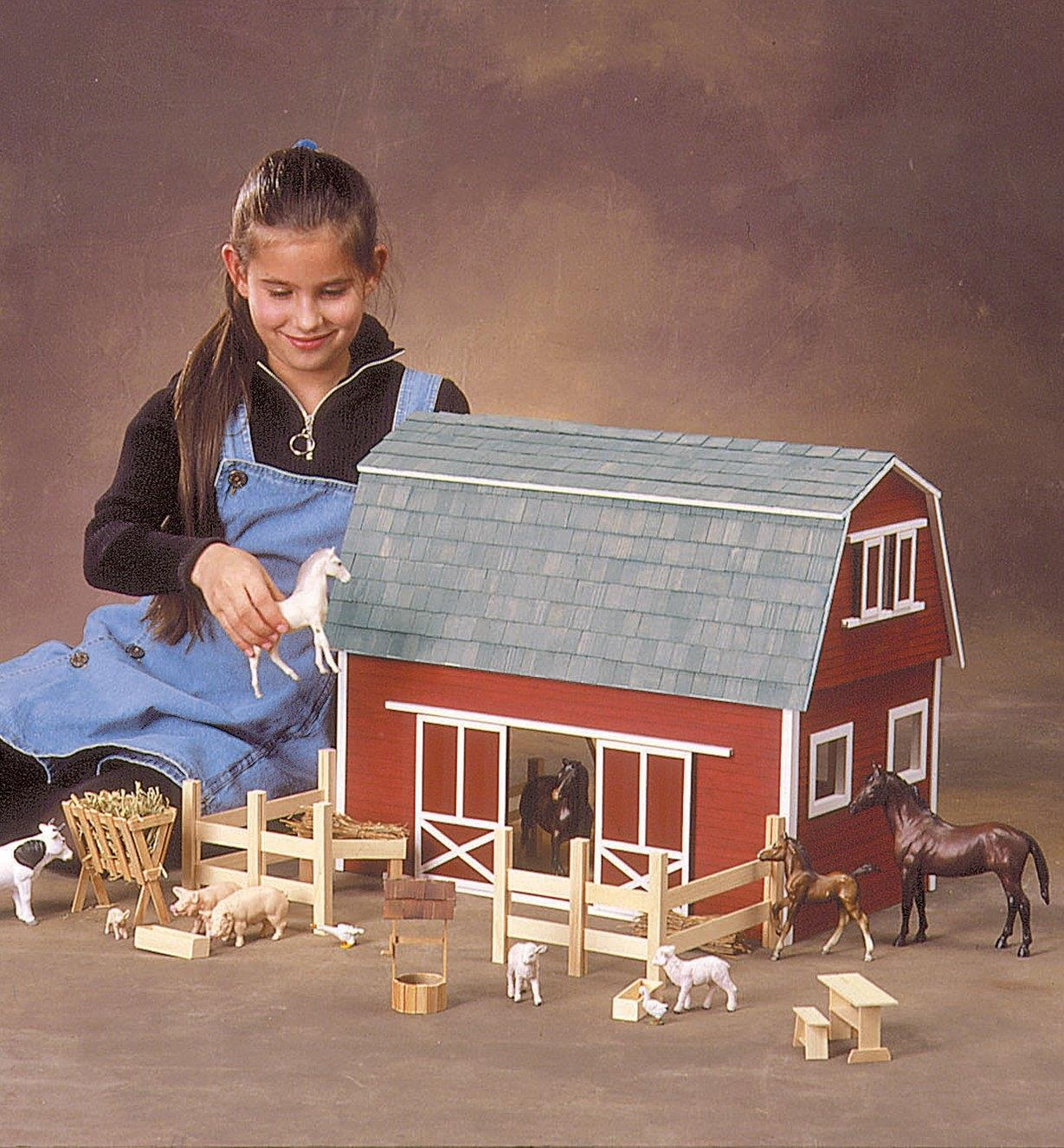 A child plays with the assembled barn and farmyard animals