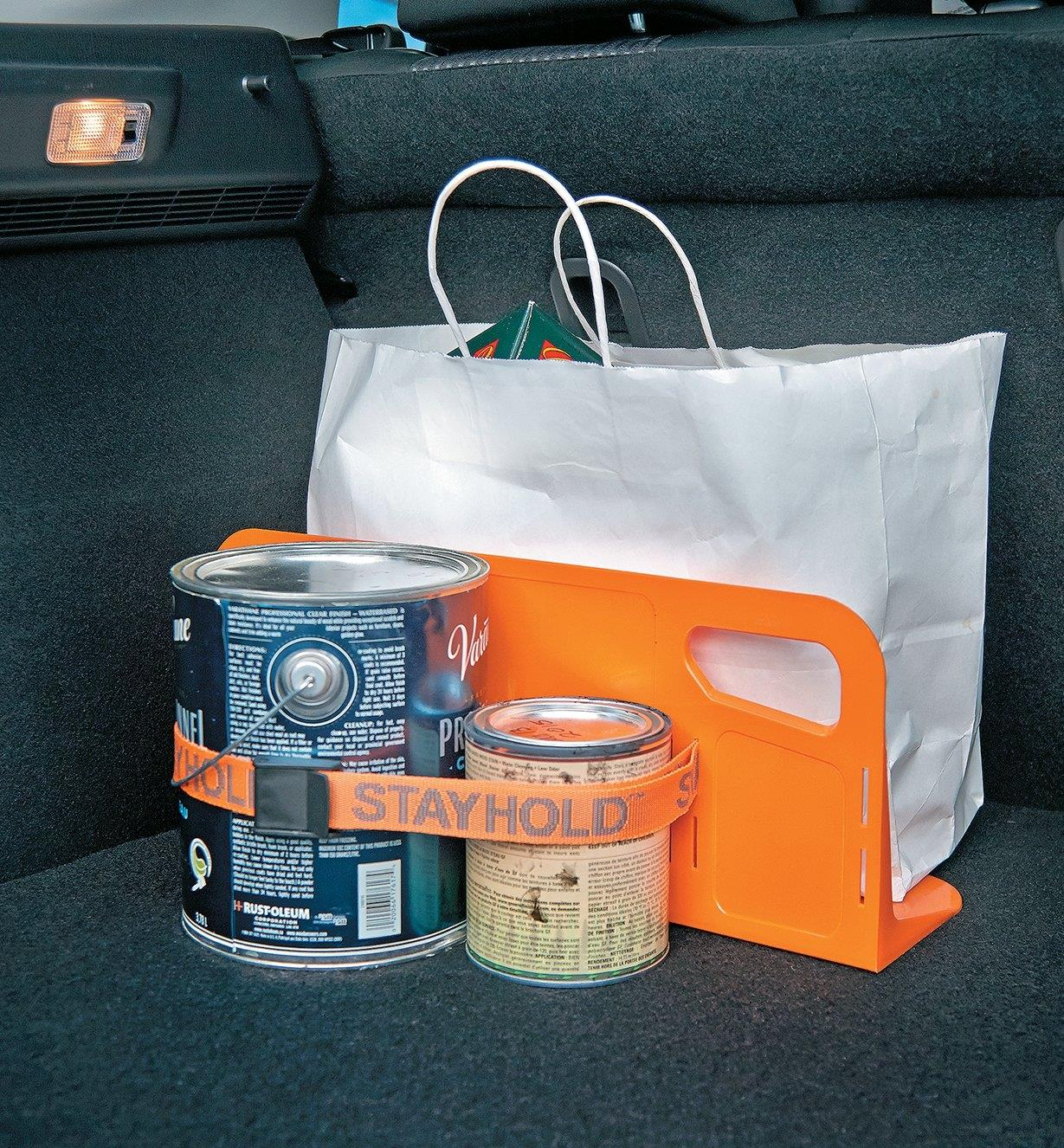 "18"" Cargo Organizer Bracket supporting a shopping bag and holding paint cans in place with the optional strap"