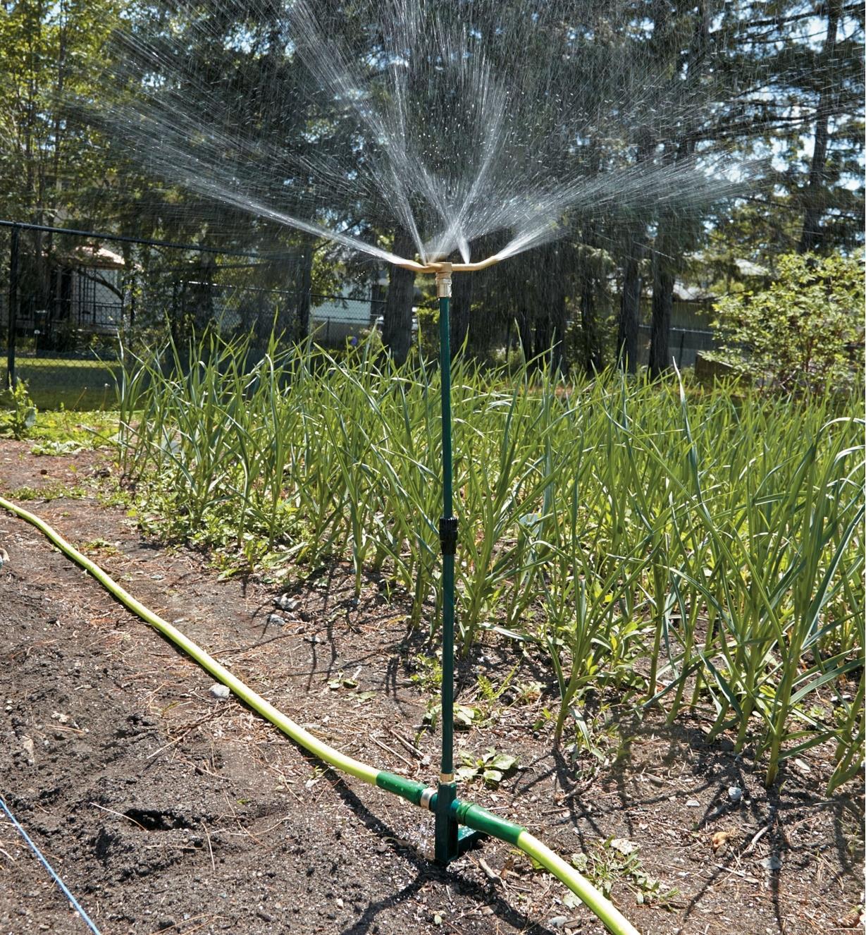 Telescoping Rain Sprinkler watering a garden