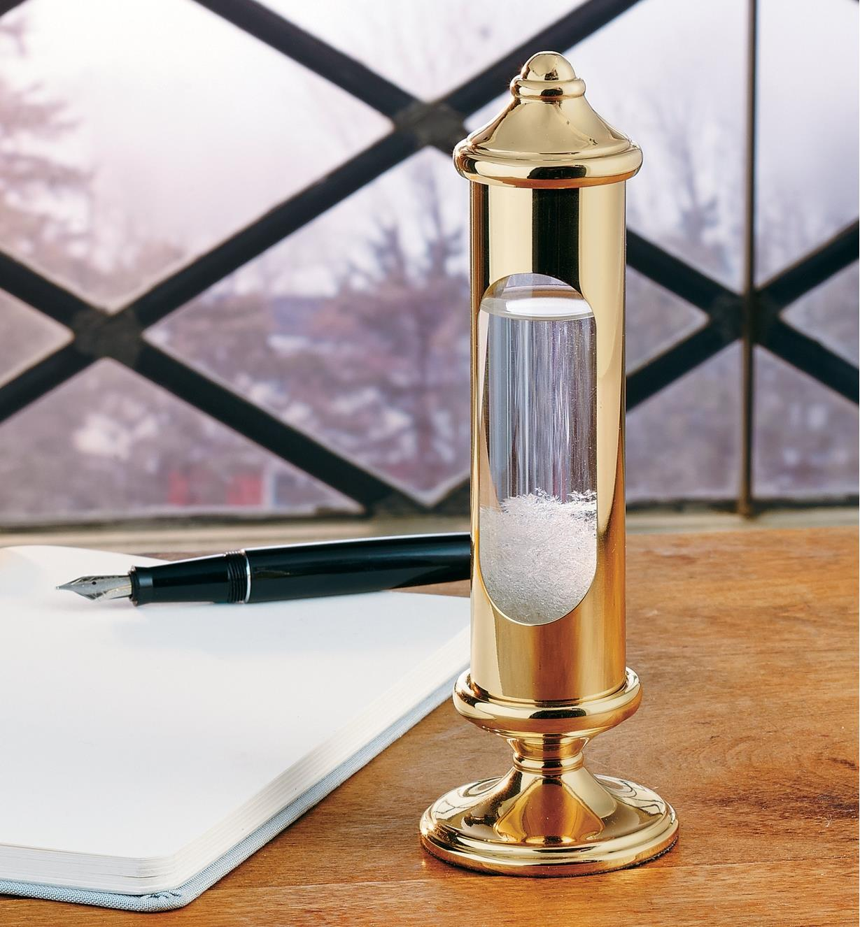 Admiral FitzRoy's Stormglass sitting on a desk by a window