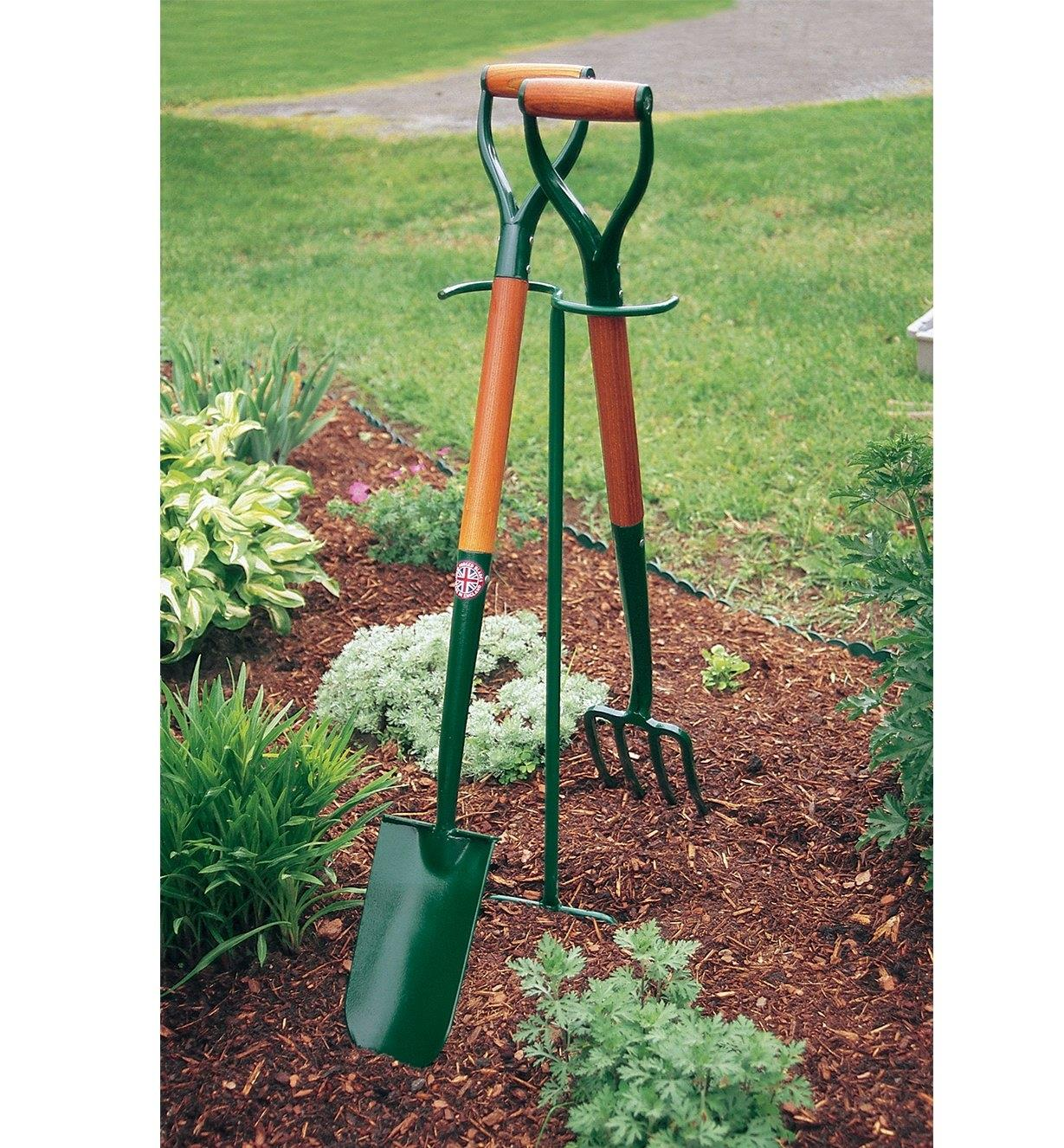 Macgregor Tool Butler supporting a shovel and fork in a garden
