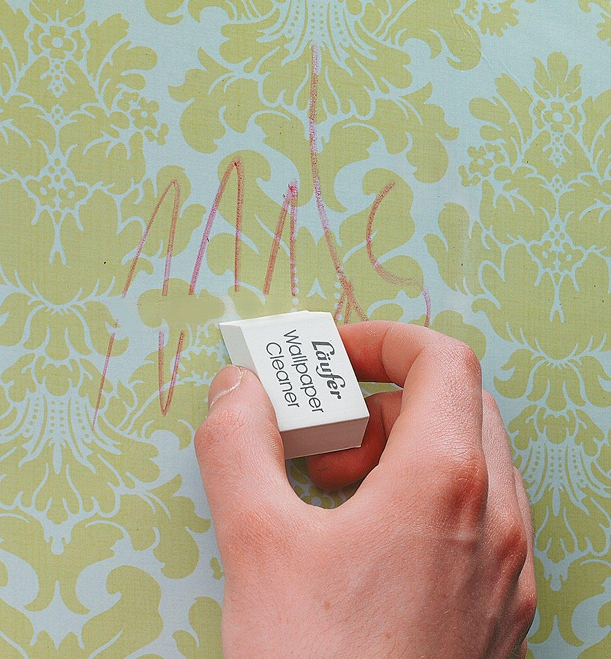 Using the wallpaper eraser to clean crayon marks off wallpaper