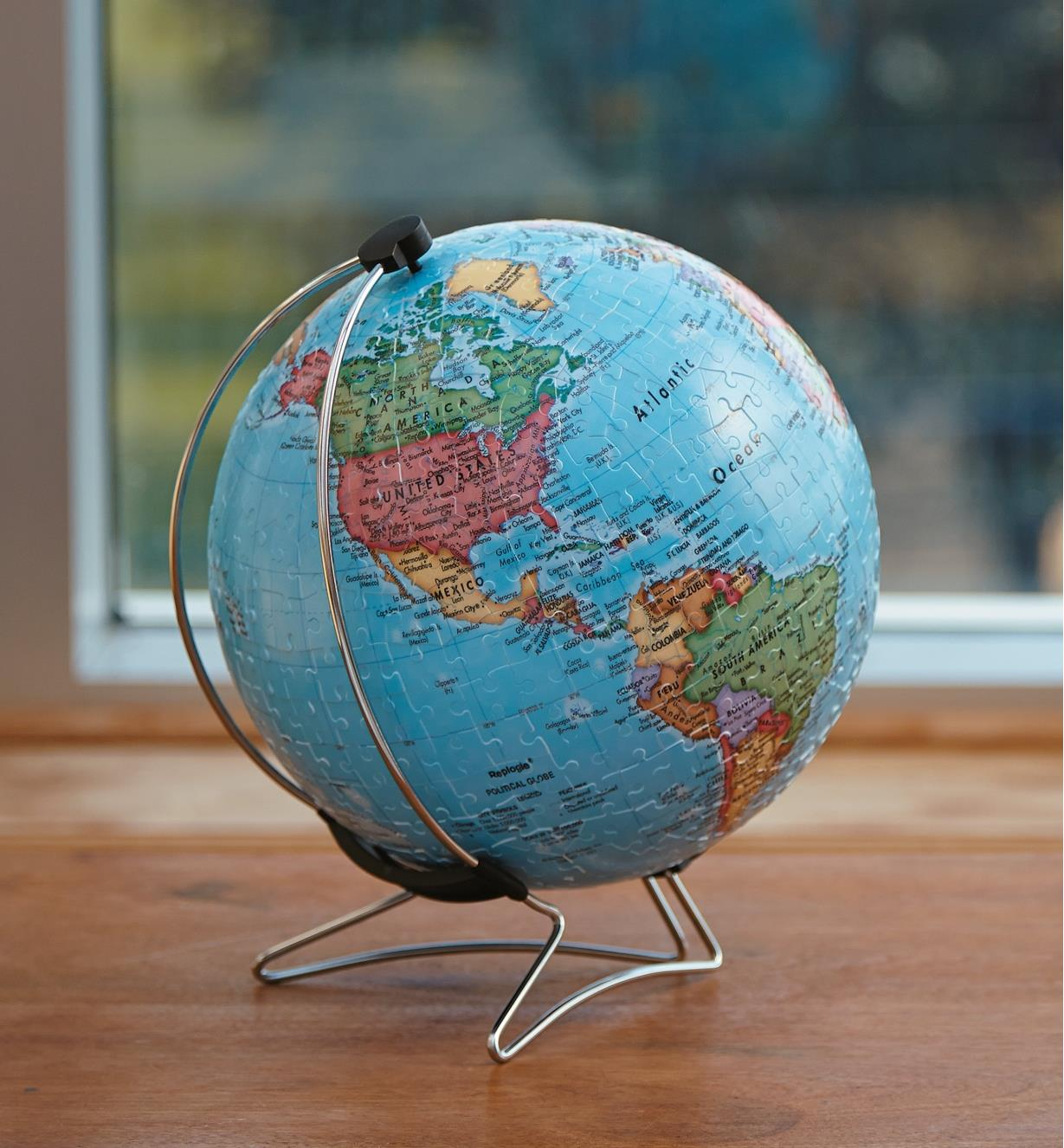 Completed 3D Globe Puzzle sitting by a window