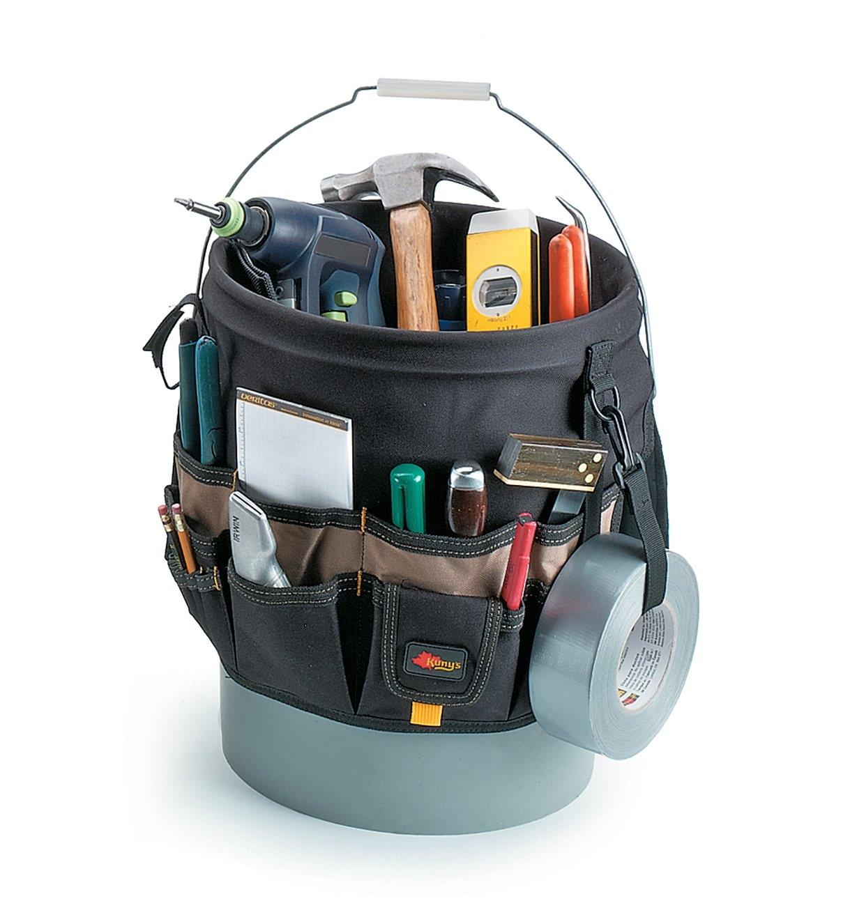 48-Pocket Tool Carrier mounted on a bucket, with tools inside and in the outer pockets