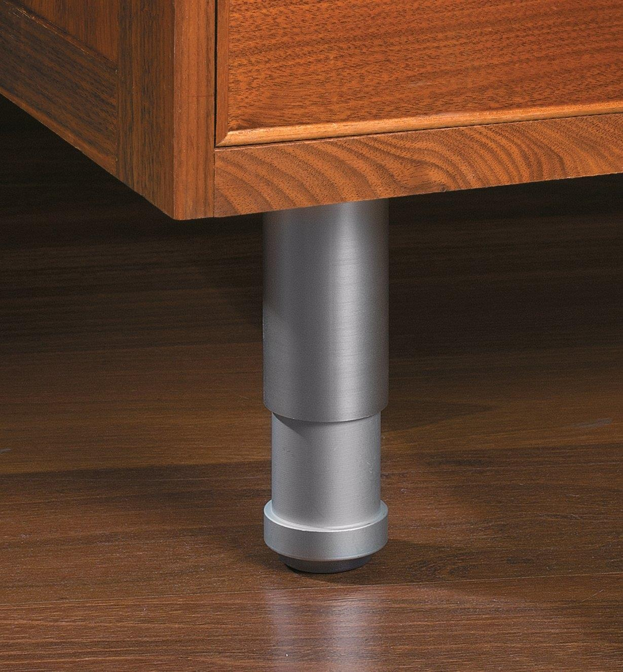 Example of a satin aluminum leg supporting a furniture piece