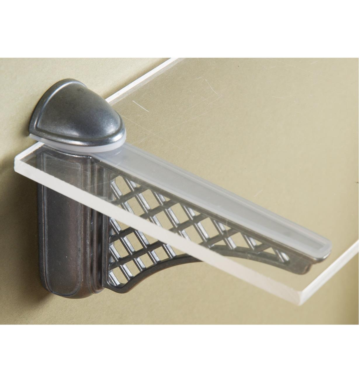 Colonial Dark Bronze Adjustable Bracket mounted on a wall with a glass shelf