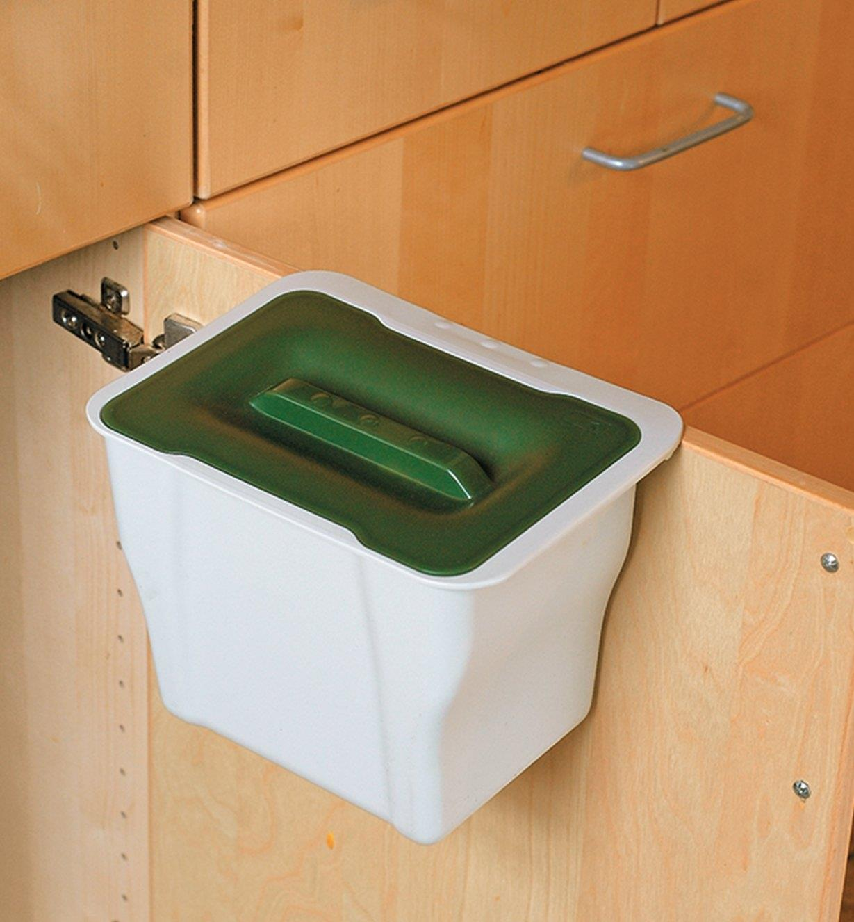 A Countertop Collection Bin hung over the inside of a cupboard door