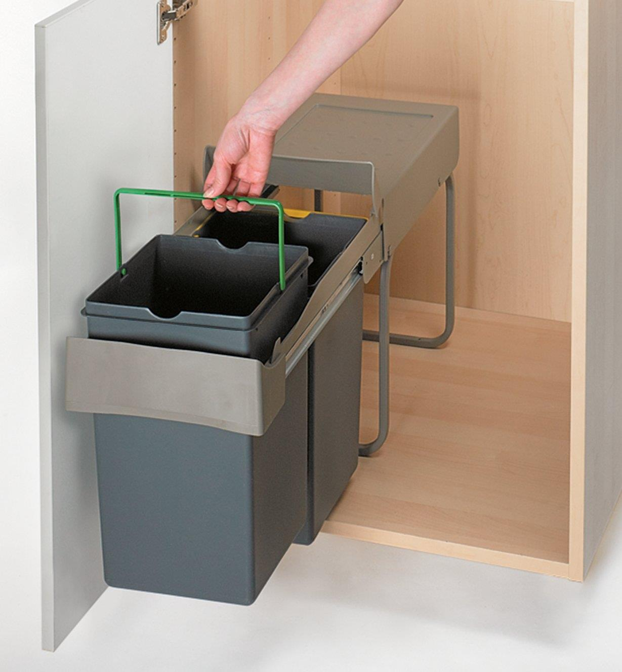 Lifting out one of the bin inserts by the handles