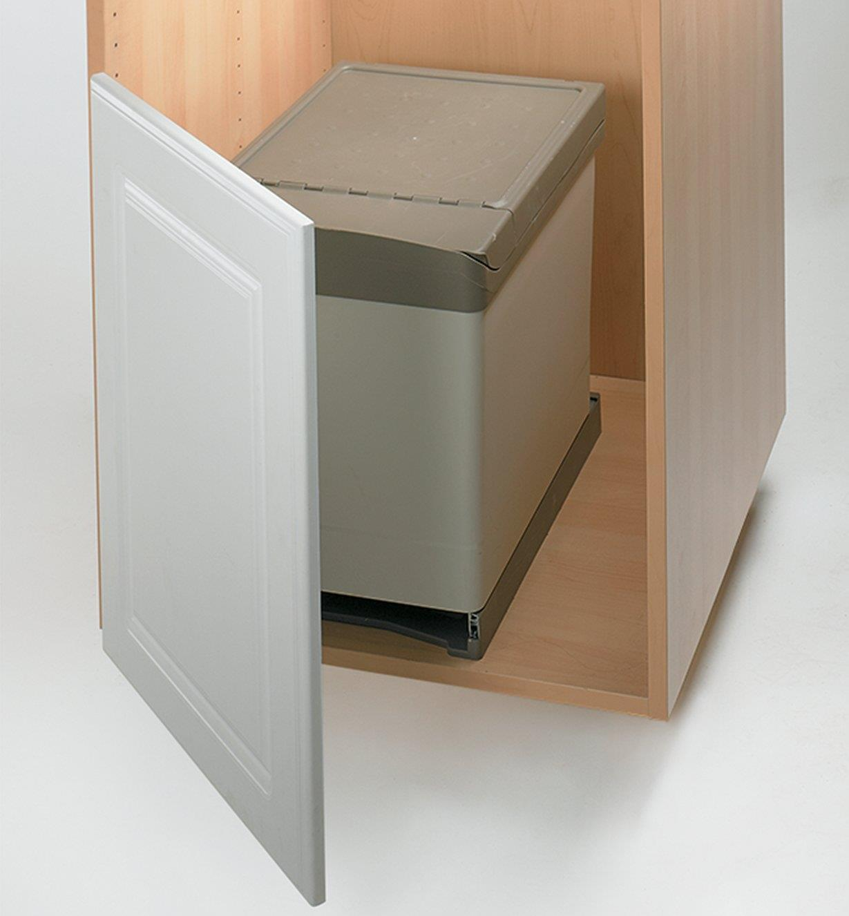 Waste container fully retracted into the cabinet