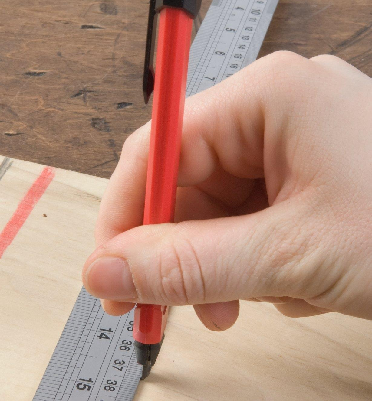 Marking a line in wood against a ruler using the Carpenter's Retractable Lead Pencil