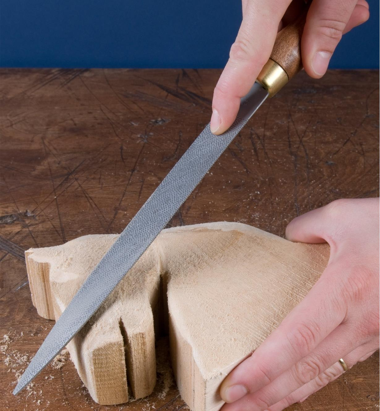 Shaping a horse-head carving with a cabinetmaker's rasp
