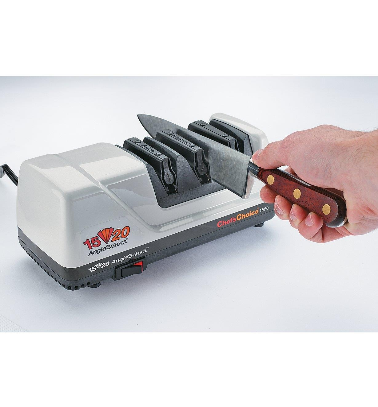Sharpening a knife in the Chef'sChoice 15°/20° Dual Knife Sharpener, Model 1520