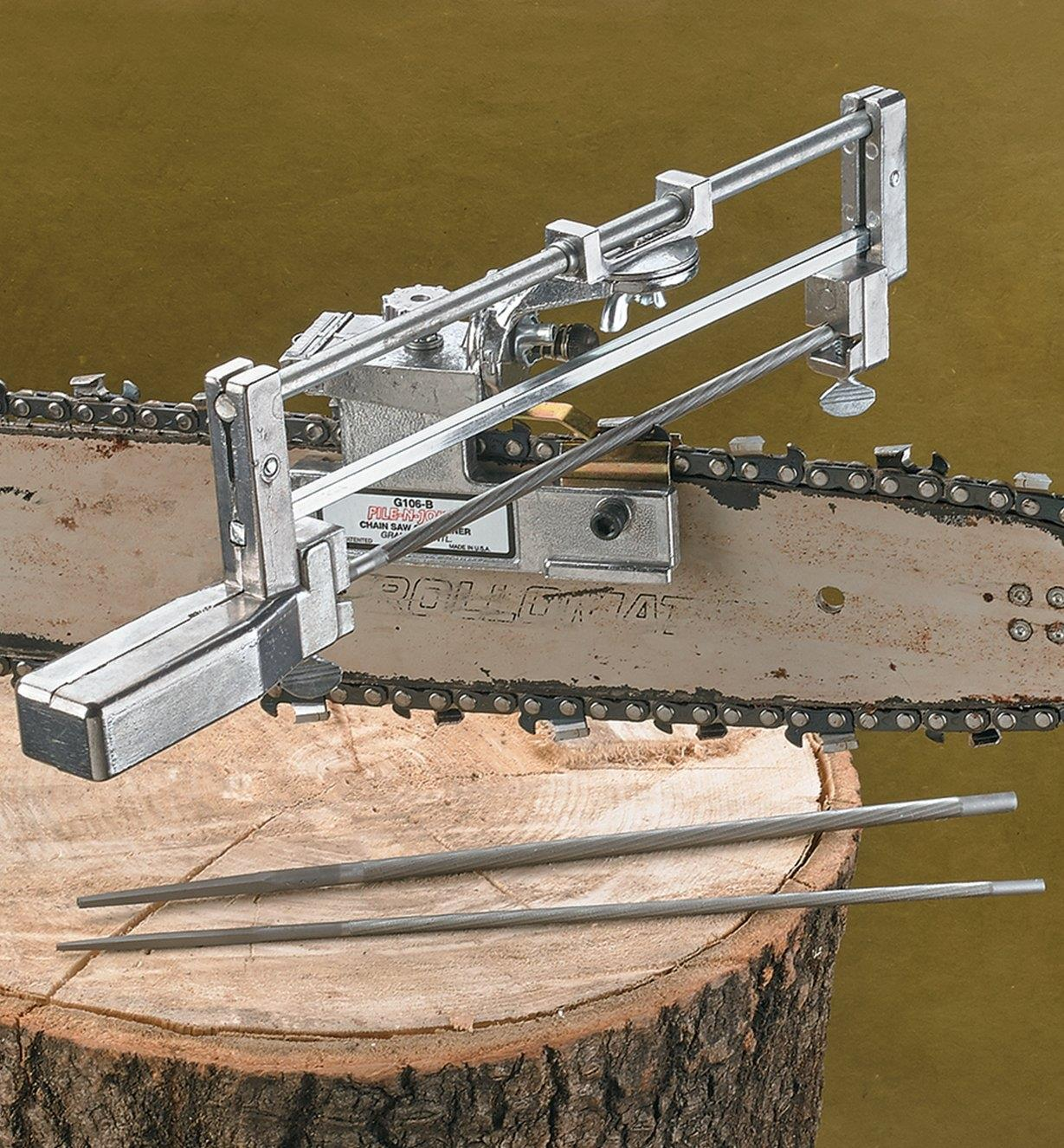 Deluxe Chain-Saw Sharpener clamped to a chain-saw bar