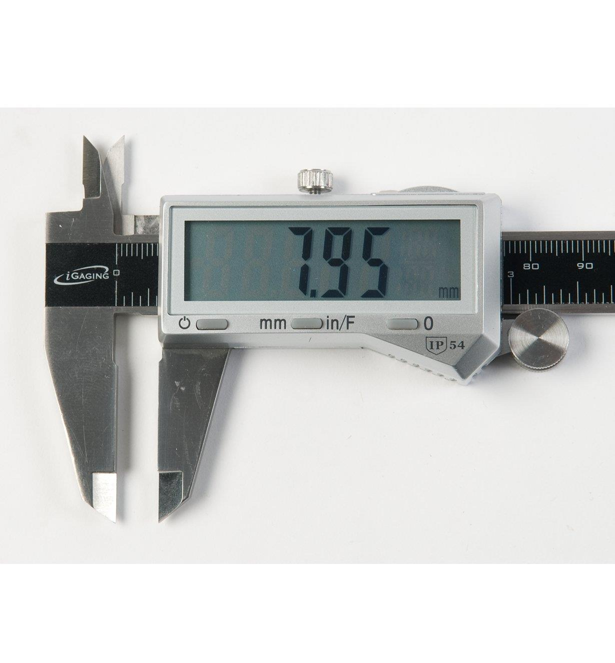 Close-up of caliper screen showing measurement in millimetres