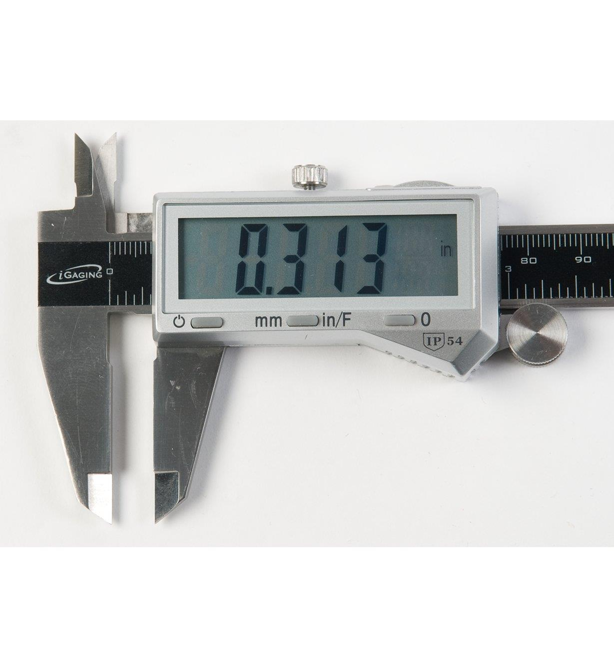 Close-up of caliper screen showing measurement in decimal inches