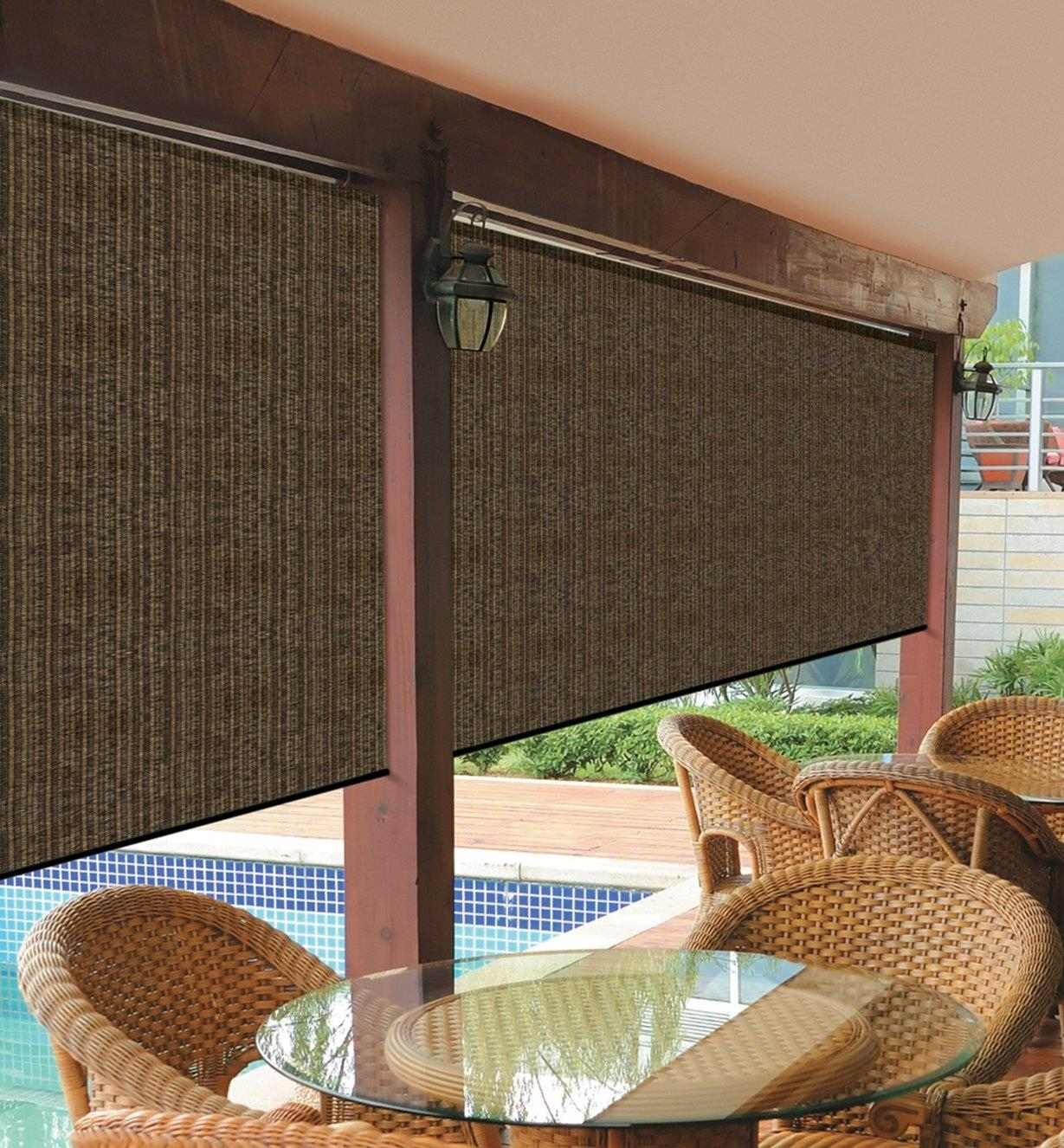 Two Coolaroo Roller Blinds installed on a pool deck