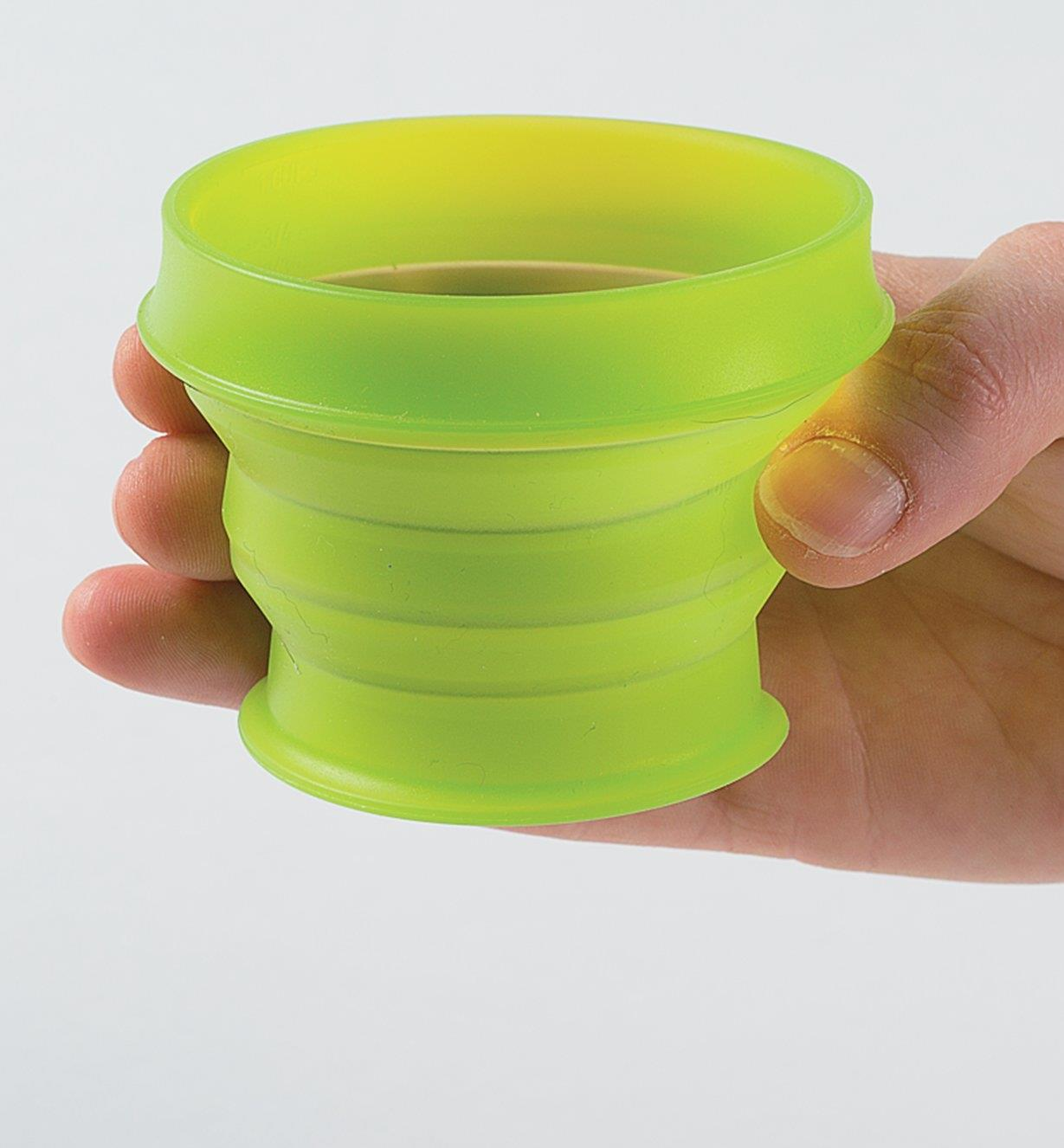 Holding a Green Collapsible Cup in a hand