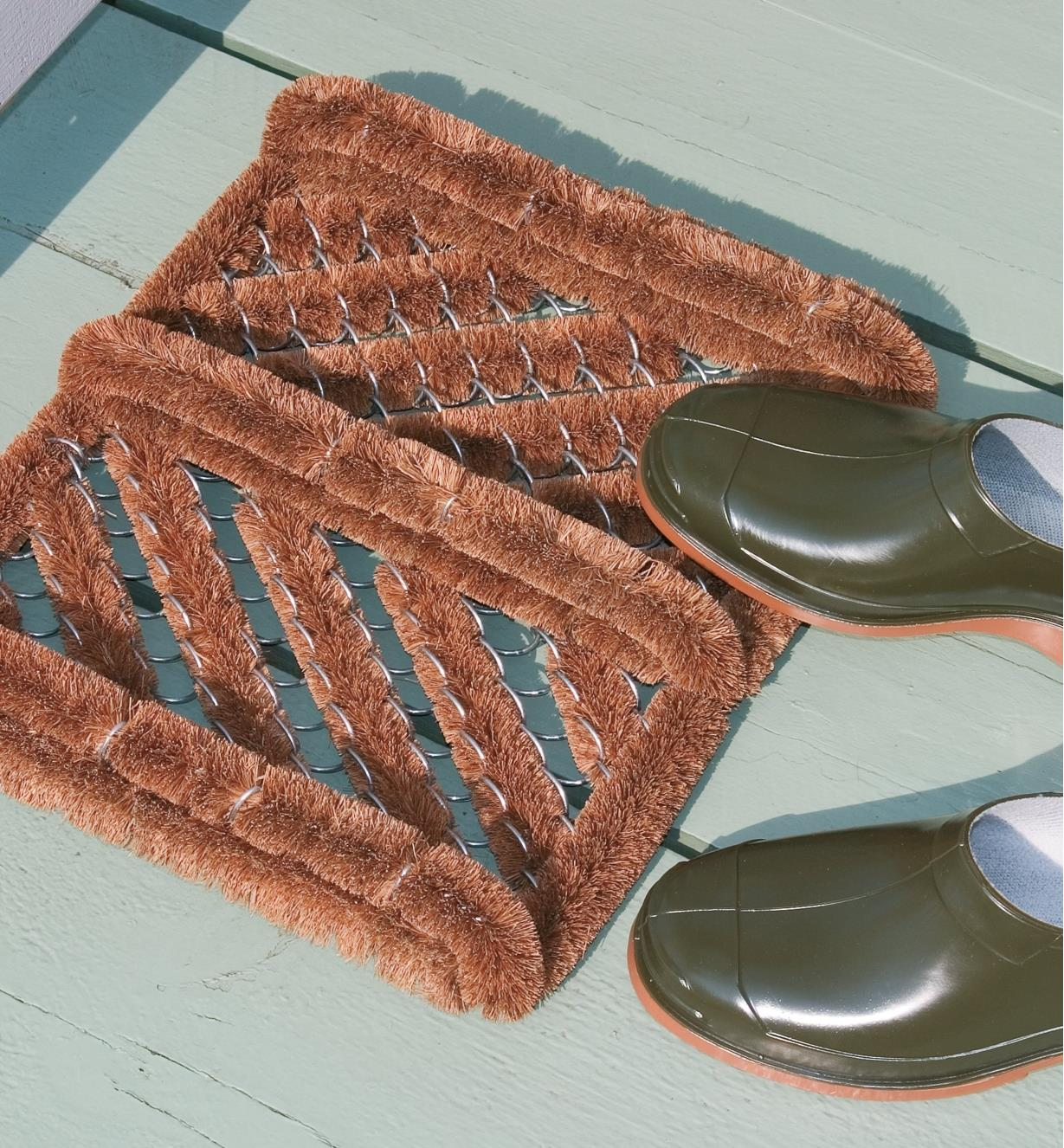 Coir Boot Brush on a deck with a pair of shoes