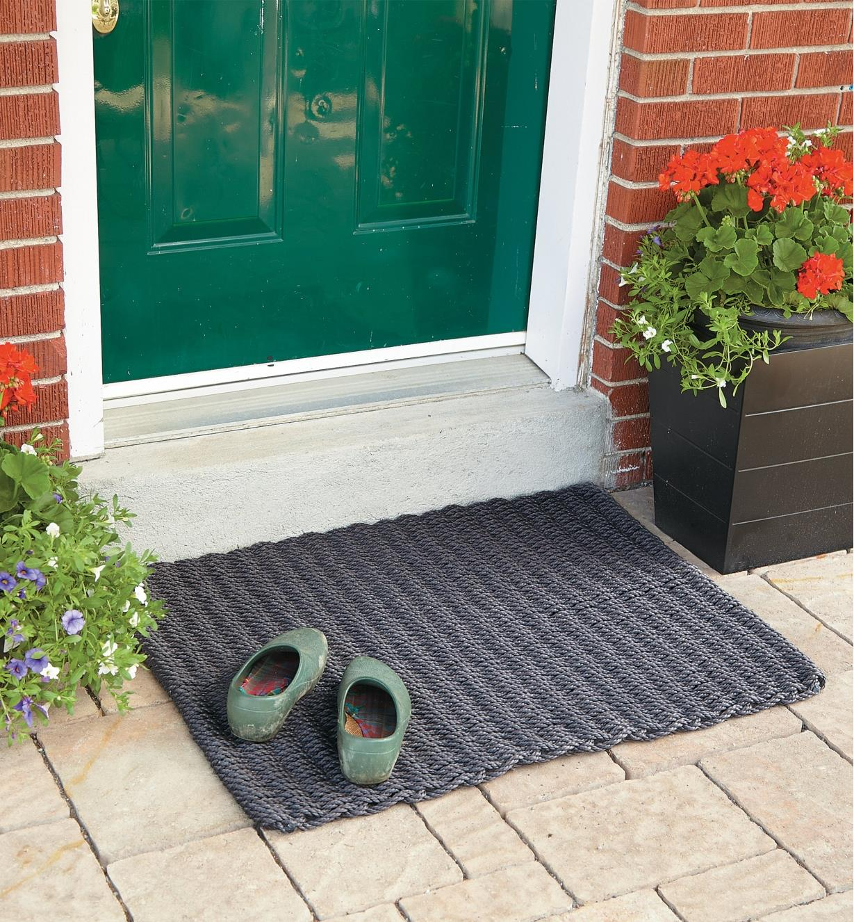Large Cape Cod Doormat placed outside a front door with a pair of shoes on it