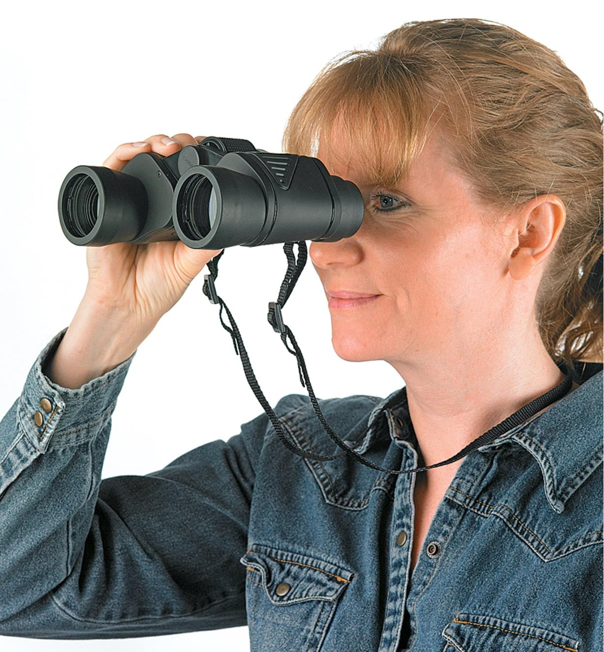 A woman looks through a pair of Binoculars