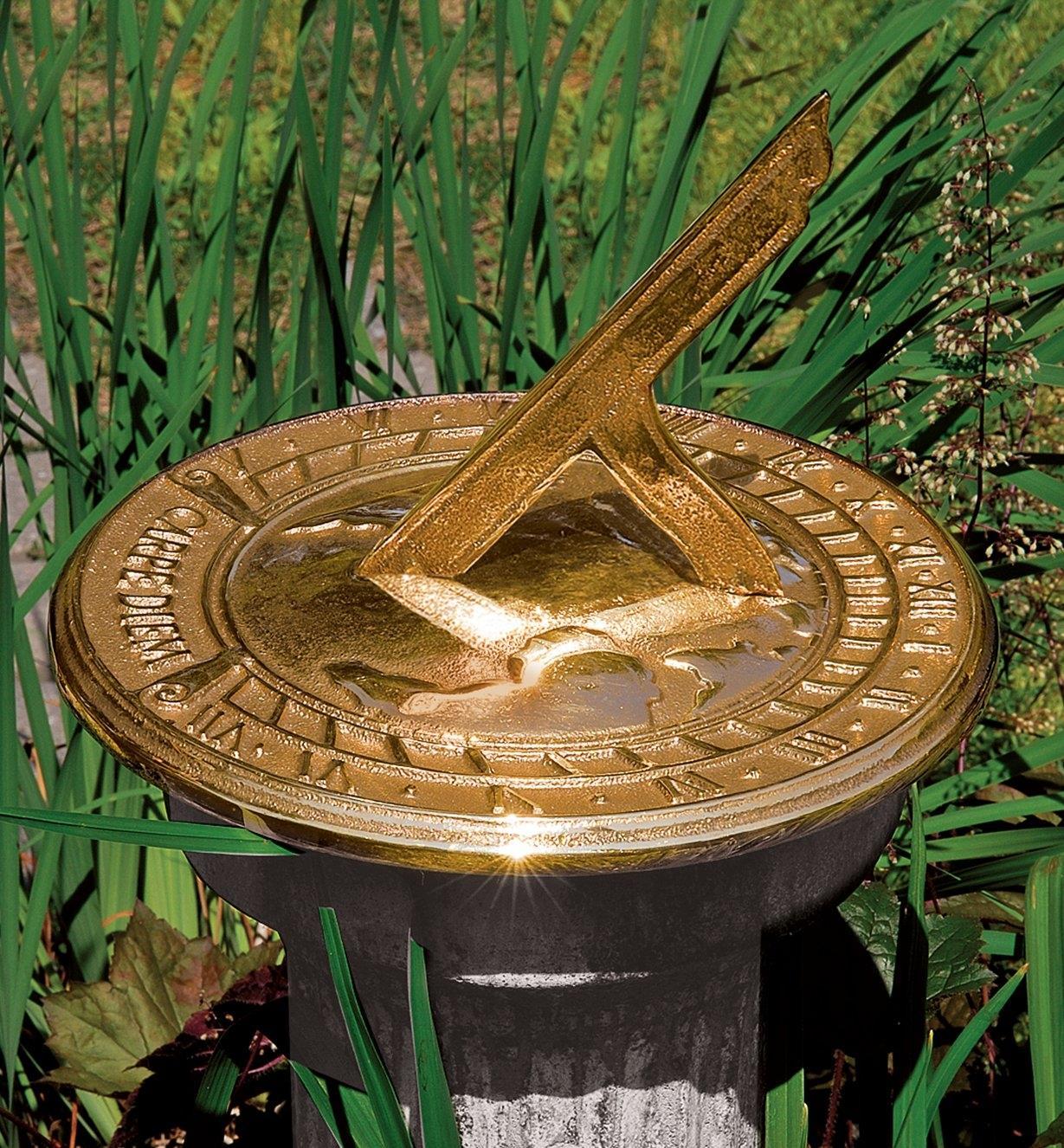 Bronze Sundial on a pedestal in the garden