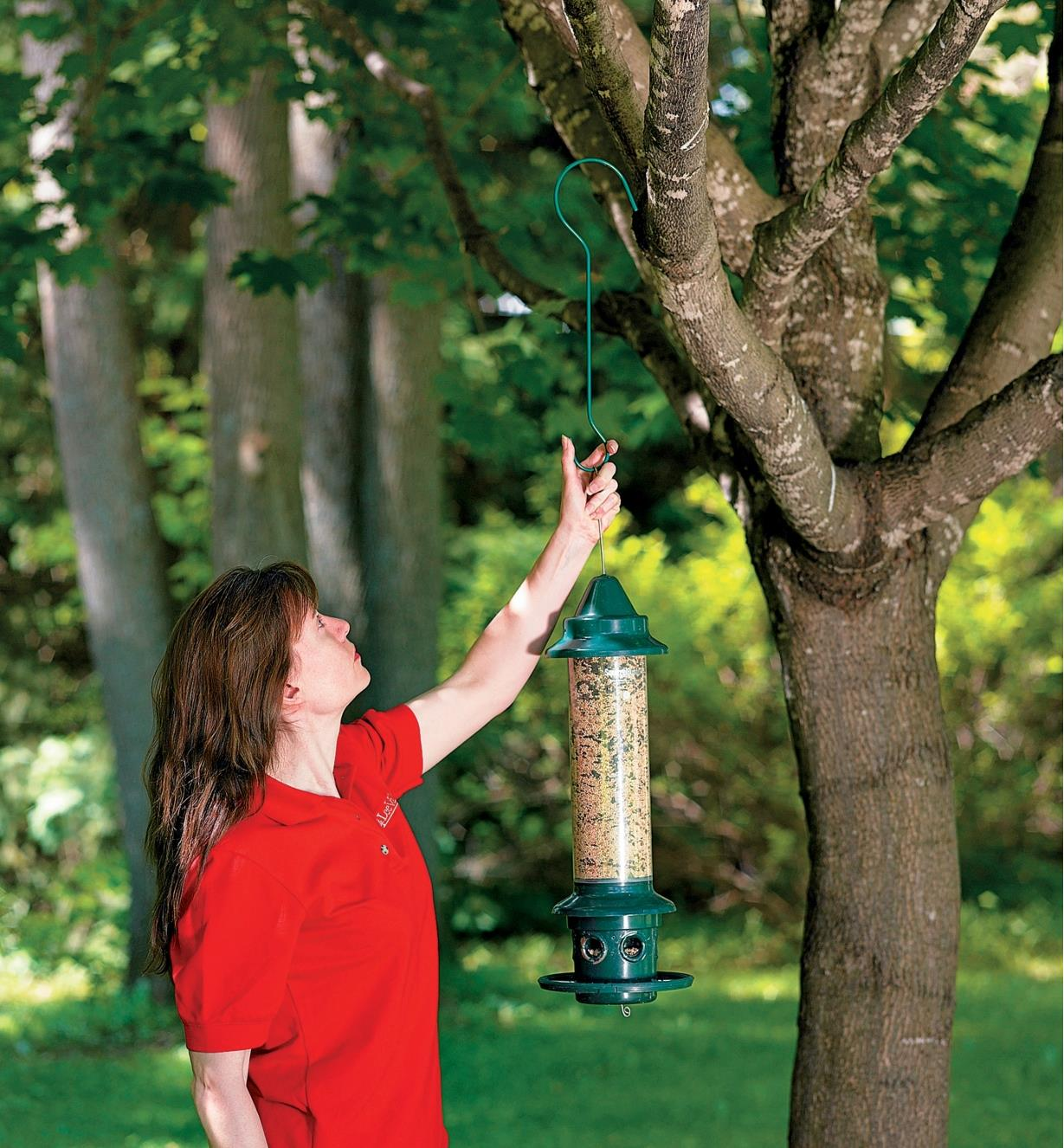 Hanging a bird feeder in a tree using a large garden hook