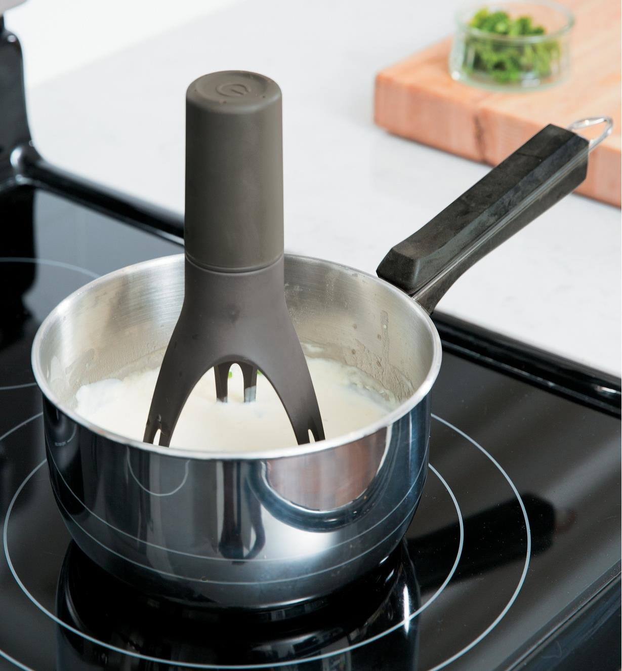Auto-Stirrer stirring sauce in a pot on a stove