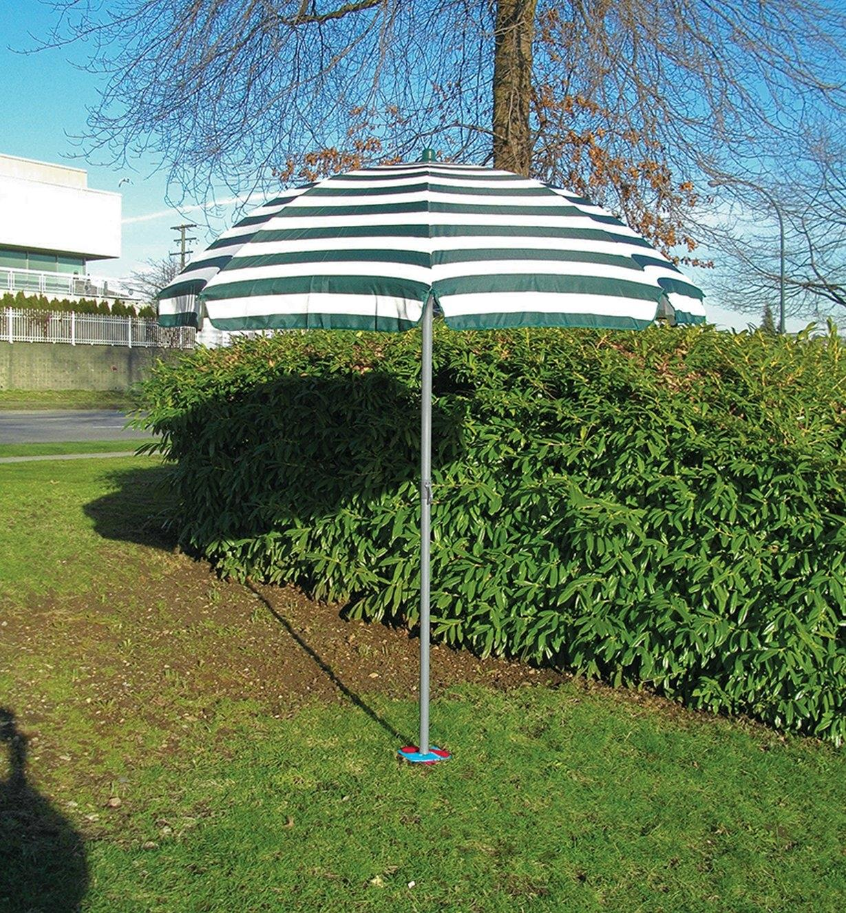 Ground screw installed in the ground, holding up an umbrella
