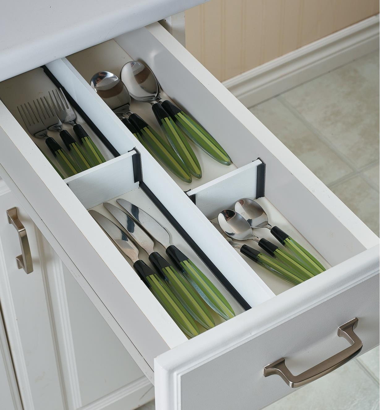"1/4"" Drawer Divider Extrusions used to install dividers in a cutlery drawer"